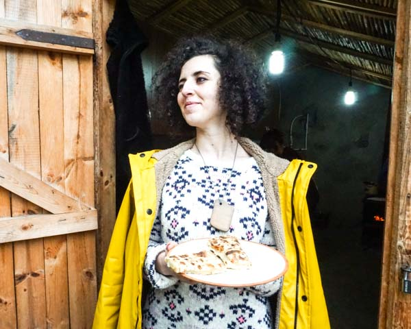 Saten G , another one of our Tumo student friends, is holding our sweet version of jingalov hats in a small village in Artsakh. Eating here was like eating in an alpine cabin.