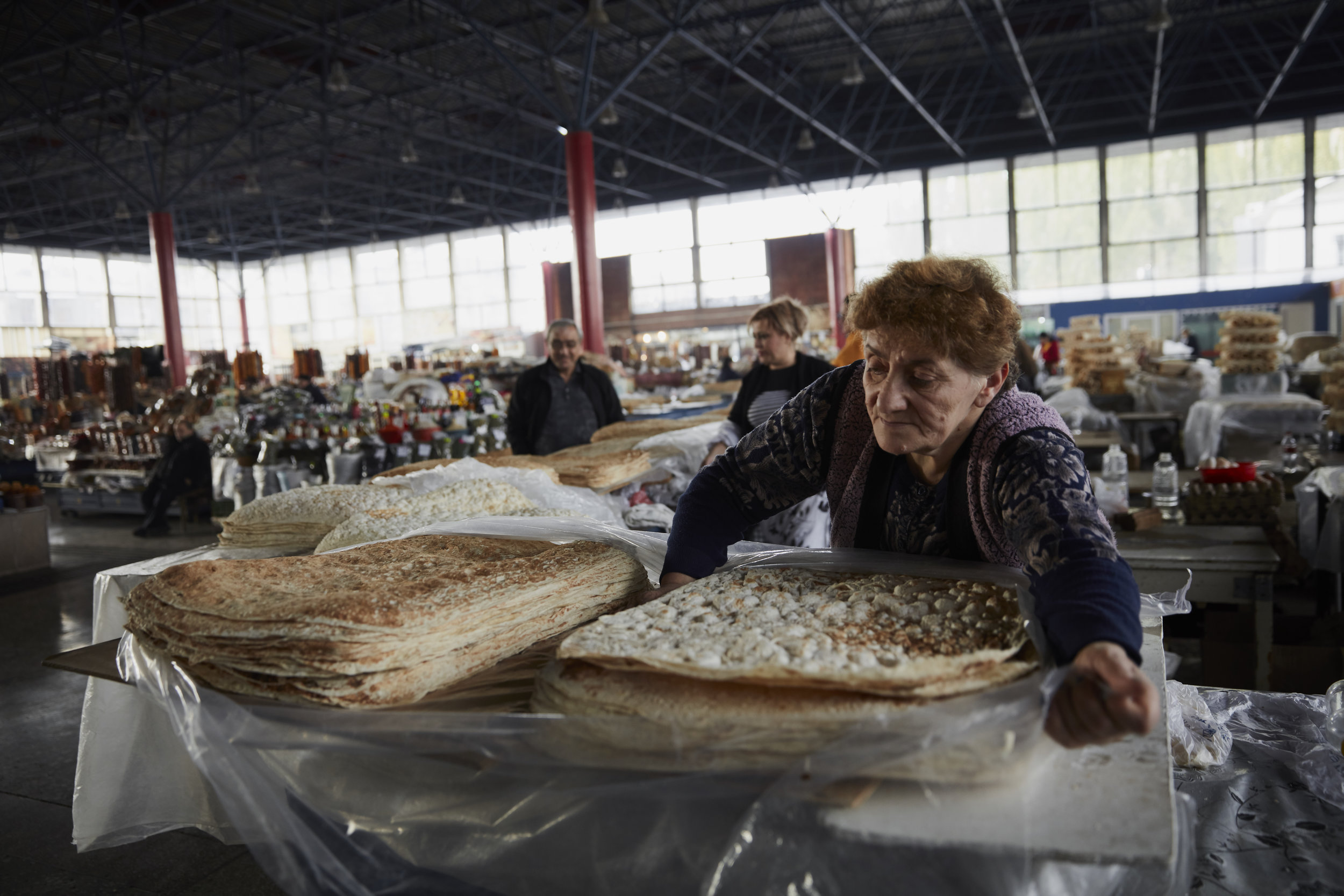 Stacks of lavash line the tables in one corner of GUM Market in Yerevan, where customers can choose between thin and thick varieties.