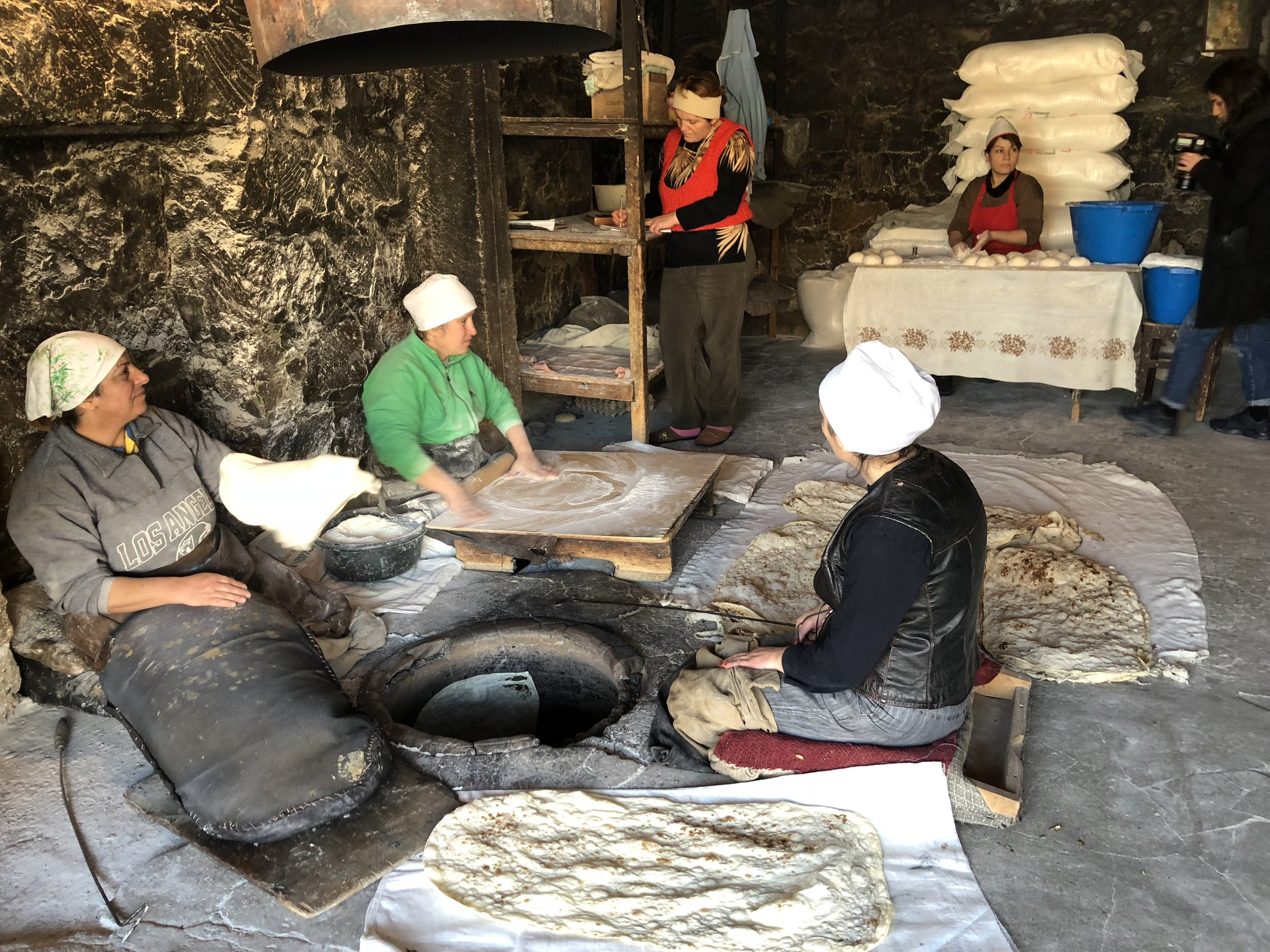 In Argel, four women are needed to mix, roll, bake, and cool the lavash. A fifth woman minds the till, counting change with an abacus when customers bought lavash