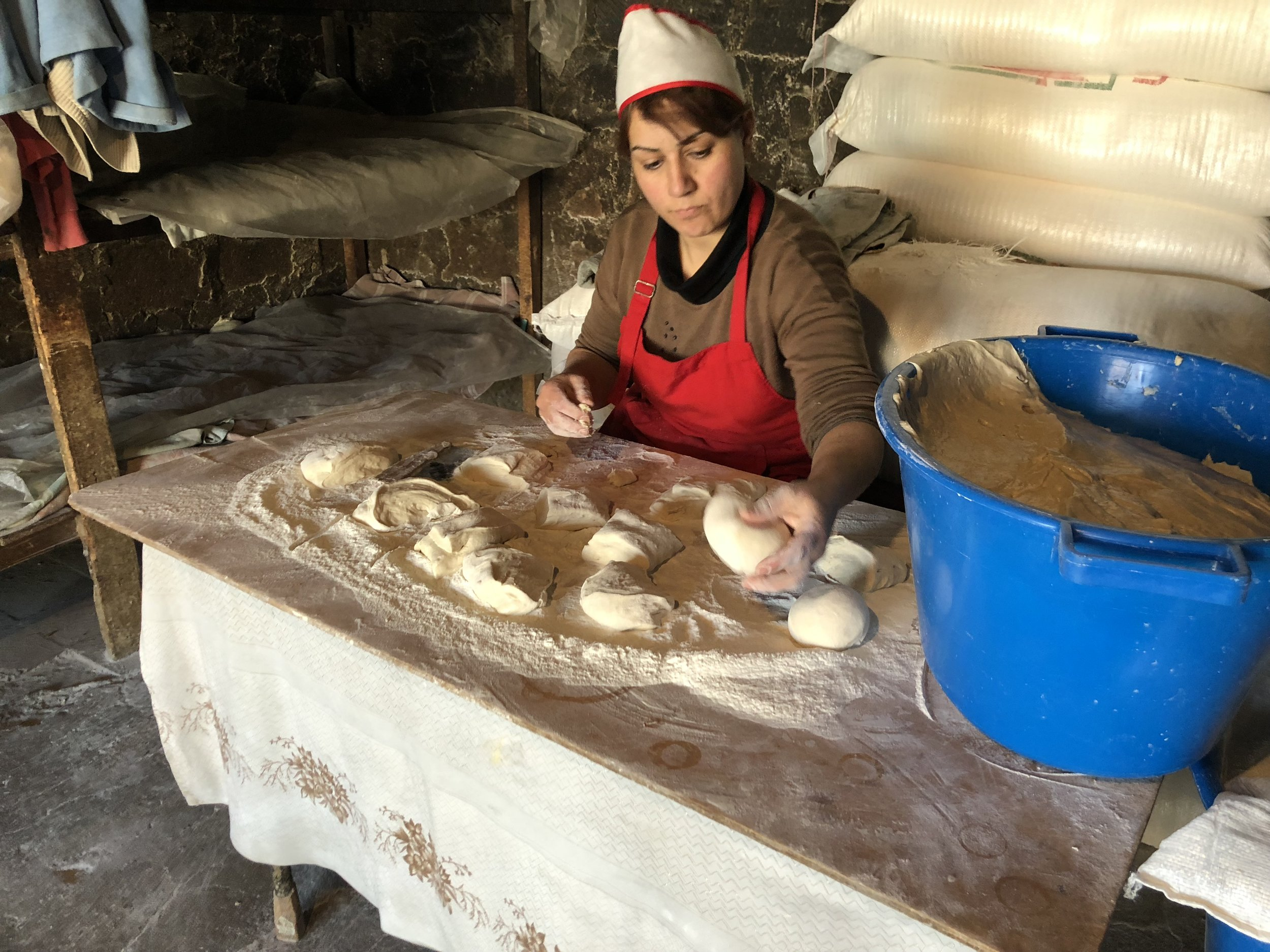 The woman who mixed the dough to make lavash was also responsible for portioning it out, which she could do by eye without the help of a scale.
