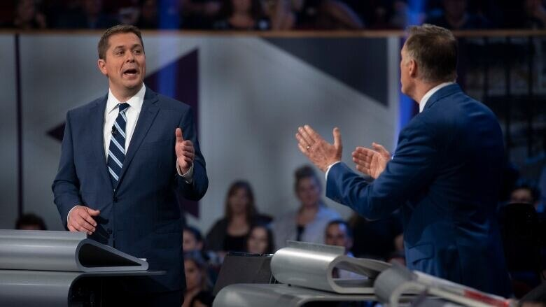 Scheer, Bernier only 2 in debate who wouldn't back UN Indigenous rights declaration - CBC NEWS