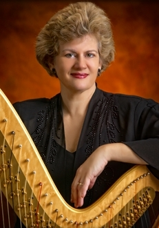 Lelia Lattimore - Lelia Hall Lattimore is the principal harpist with the Asheville Symphony, the Hendersonville Symphony, the Brevard Philharmonic and the Johnson City Symphony. She also makes regular appearances with the Asheville Lyric Opera and the Asheville Choral Society. Lelia is the founding director of the Blue Ridge Harp Ensemble, which has been delighting audiences for 20 years. This freelance musician has shared the stage with musical greats Ray Charles, John Denver and Robert Goulet. In addition to providing private and group lessons in studios in Asheville and the Shelby area, she participates in musical theater at the Peace Center, Southern Appalachian Regional Theater, Parkway Playhouse, Gardner-Webb University and Western Carolina University.