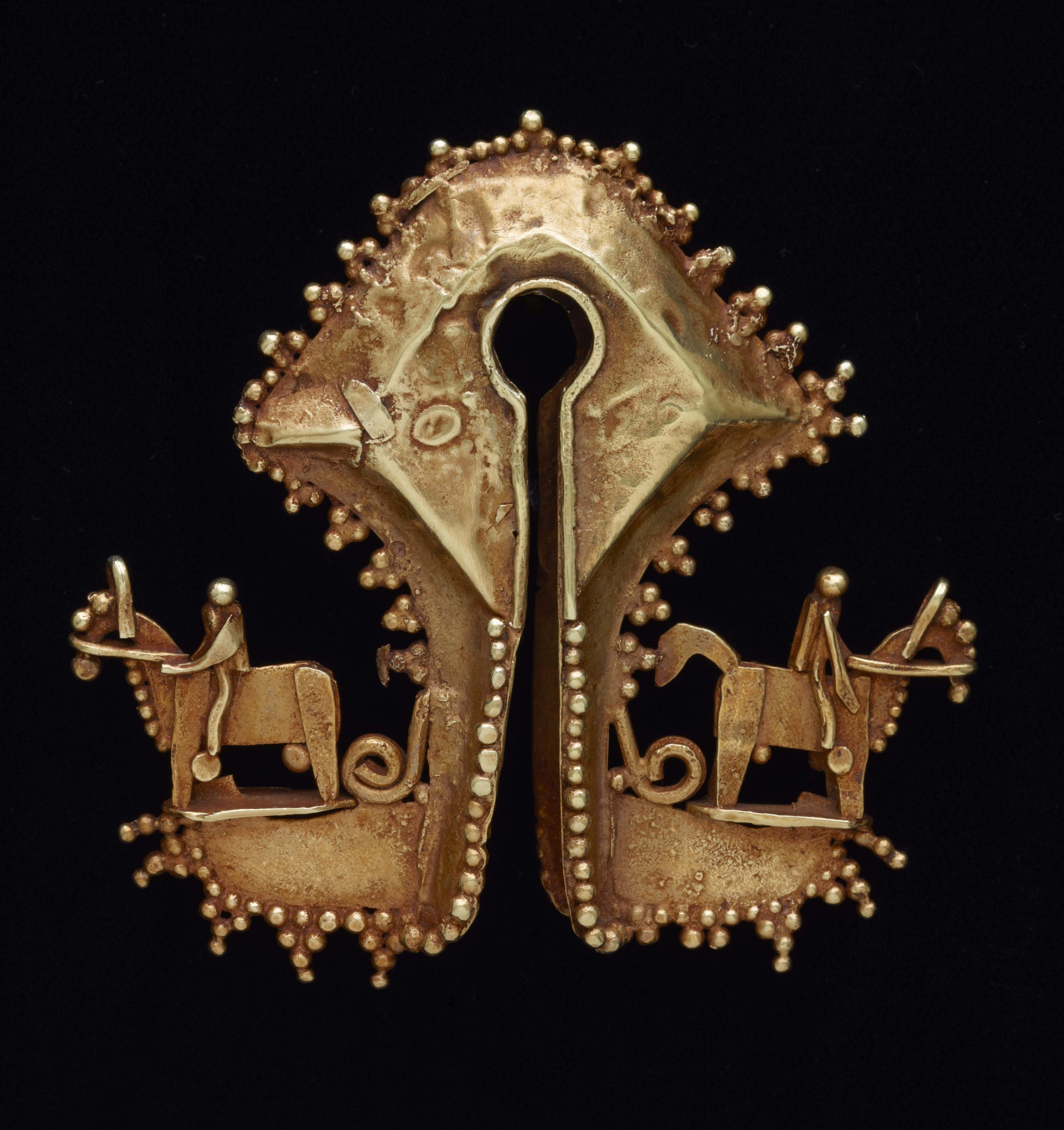 Woman's Gold Earring from West Sumba |  Mamuli  © The Dallas Museum of Art | Texas, USA