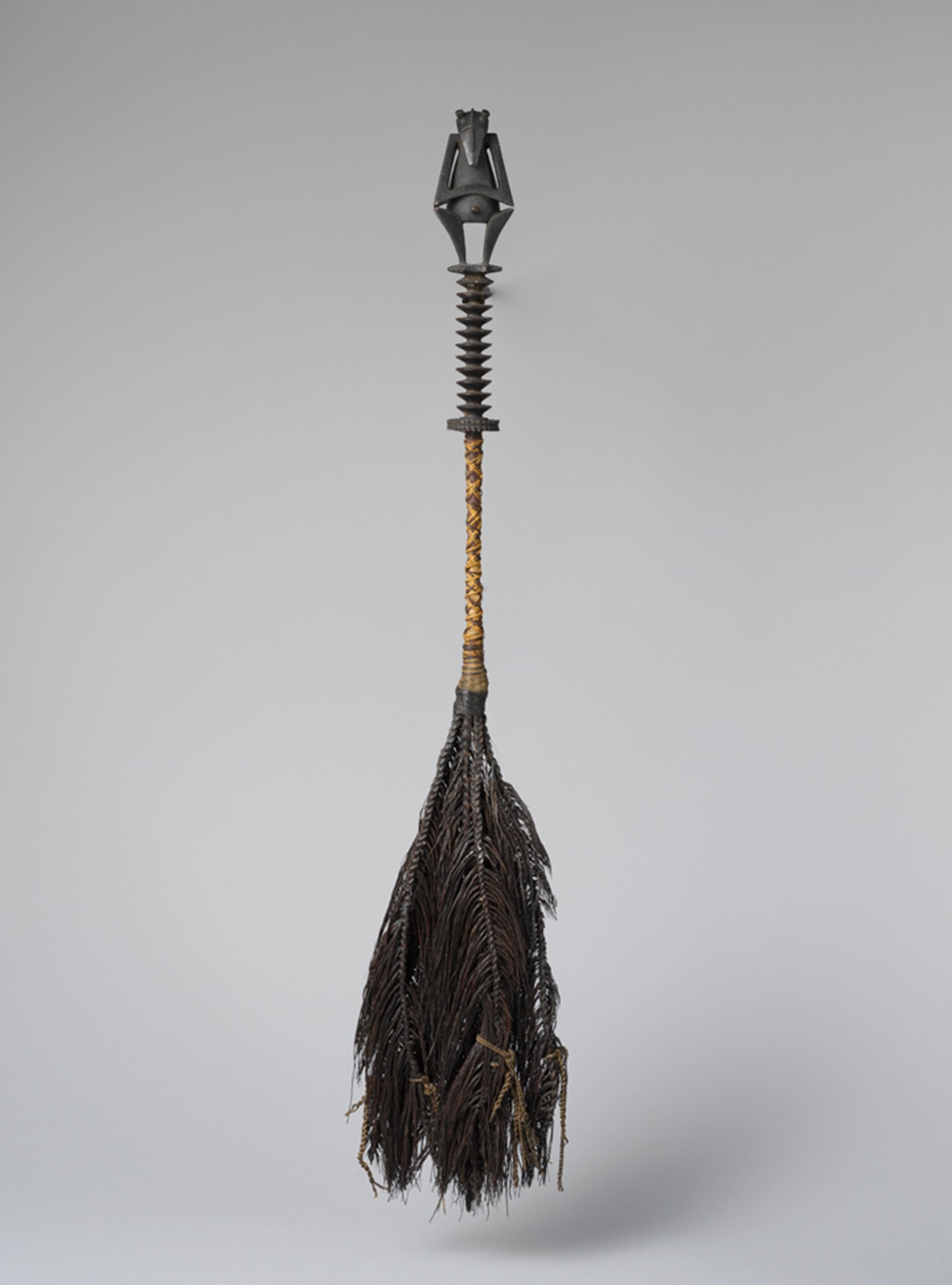 Fly whisk (tahiri) , early to mid-19th century. French Polynesia, Austral Islands. Wood, fiber, human hair, W. 5 1/8 x L. 32 in. (13 x 81.3 cm). The Metropolitan Museum of Art, New York, The Michael C. Rockefeller Memorial Collection, Bequest of Nelson A. Rockefeller, 1979 (1979.206.1487)