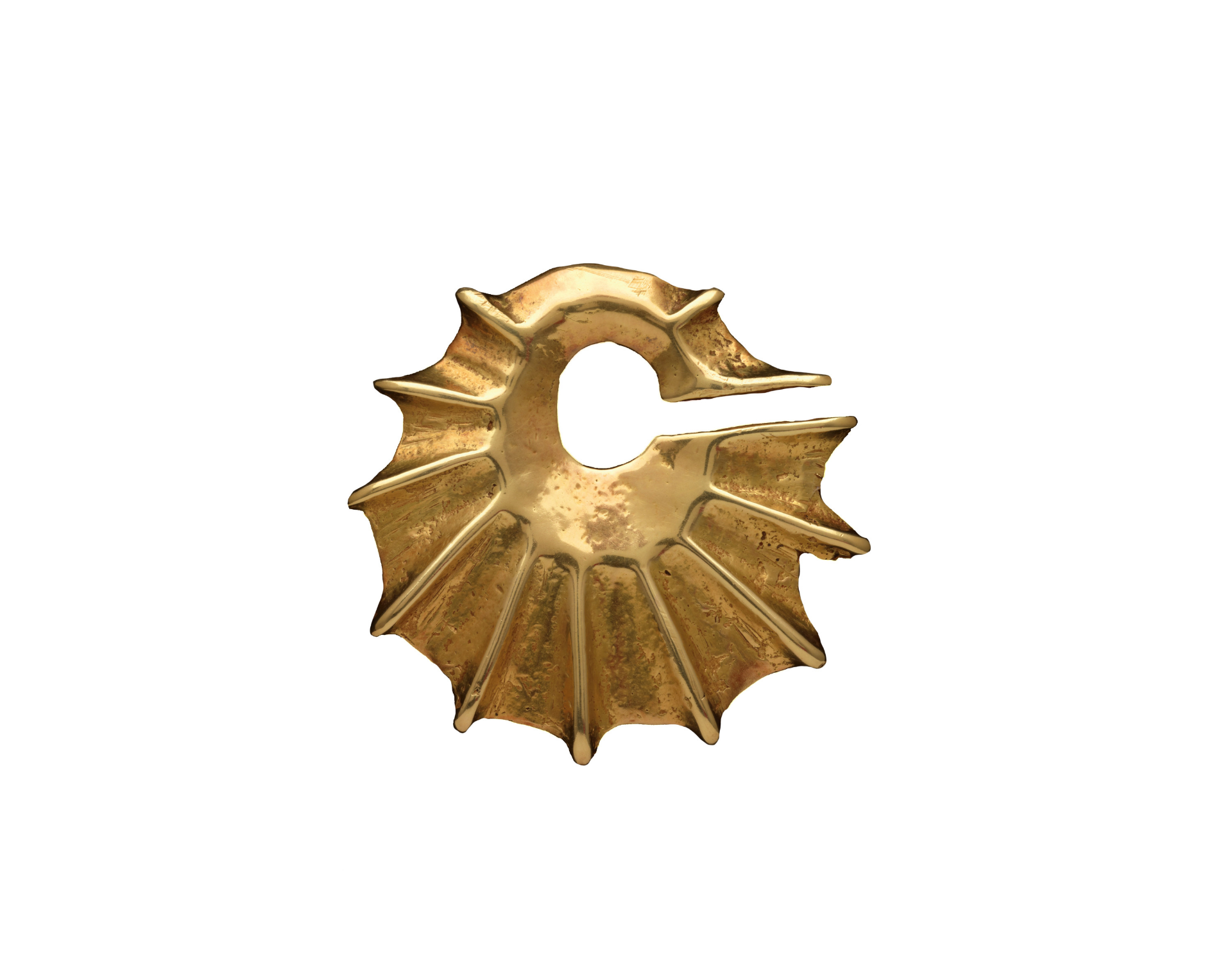 Ceremonial pendant  ( mendaka ) Indonesia, Lesser Sunda Islands, West Sumba, Lamboya, Bogar Kahale 19th century or earlier (possibly 14th to 16th century) Gold Alloy | 2 1/2 (diameter) x 1/4 (6.4 x 0.6 cm) © Dallas Museum of Art | Texas, USA