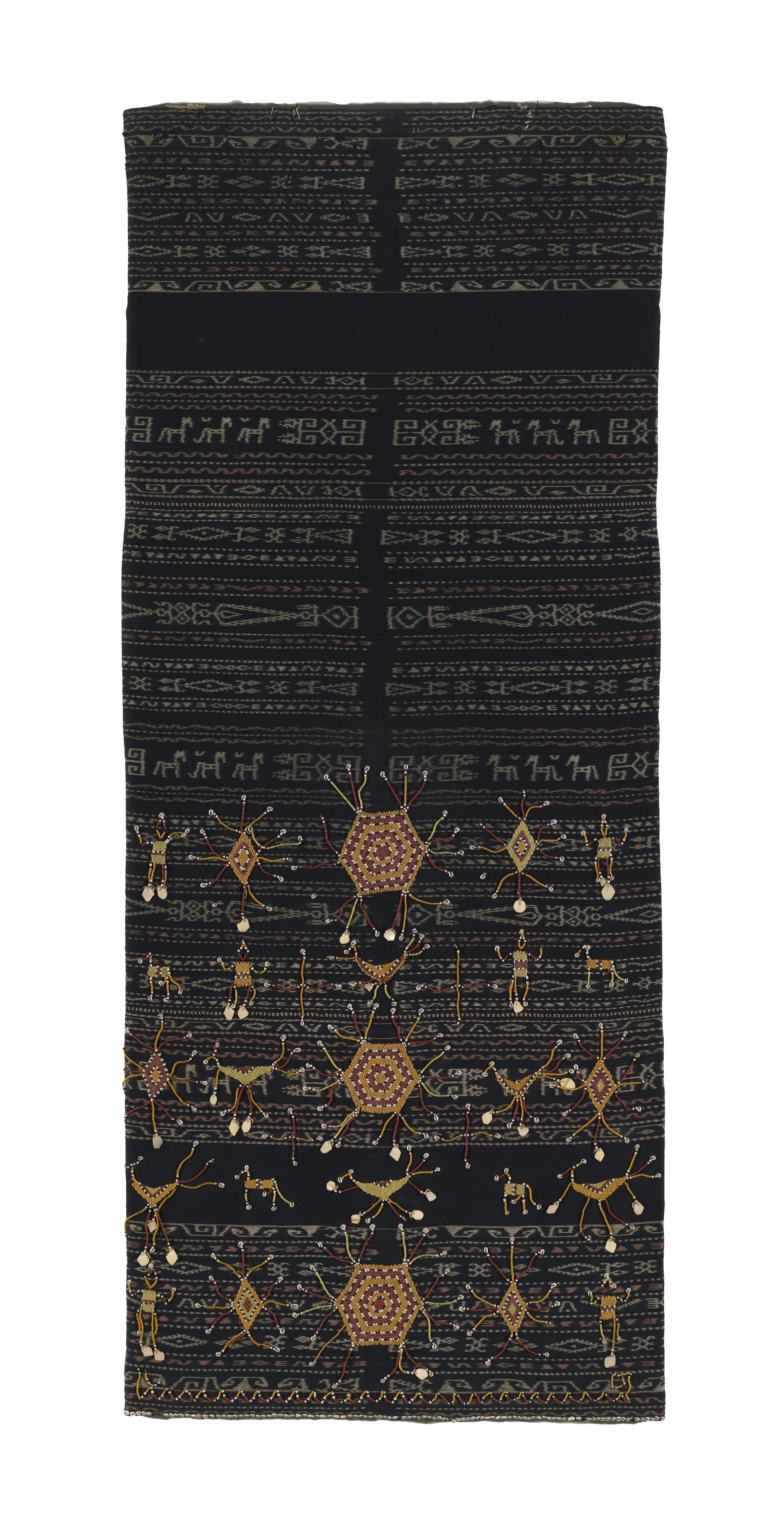 Woman's Ceremonial Skirt |  Lawo Buto  | Ngada People Late 19th Century| Bajawa District, Flores, Indonesia Cotton, Natural Dyes, Beads, Shell, Mother of Pearl Discs, Warp Ikat, Bead-Work, Applique 179.0 (h) x 74.0 (w) cm Purchased 1981 National Gallery of Australia | 1981.1141