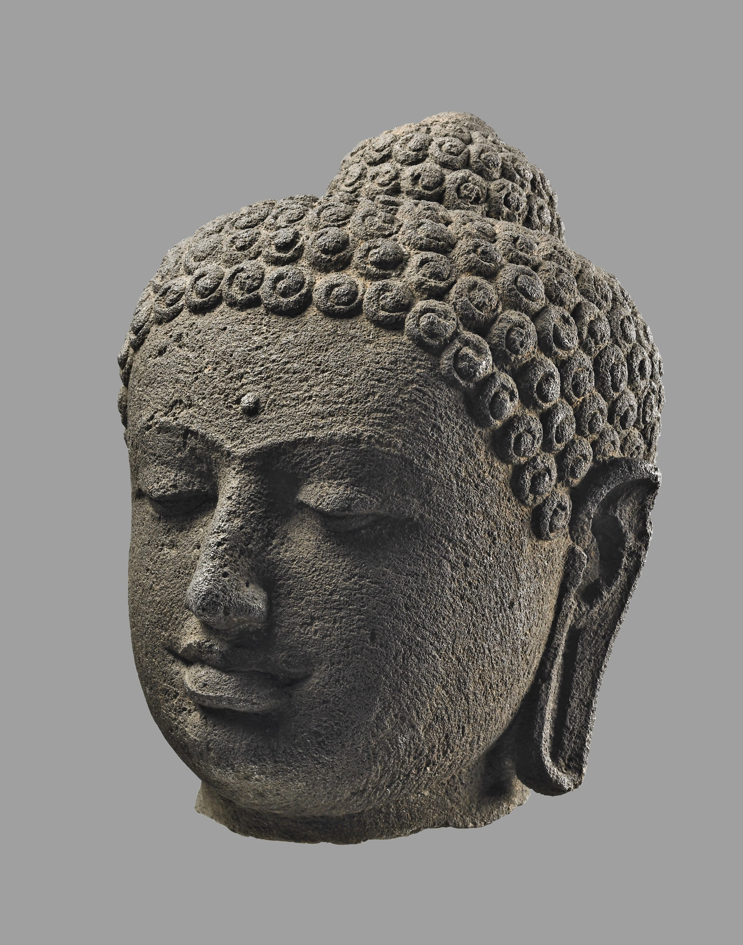 A head of the Buddha from Borobudur. © The Trustees of the British Museum