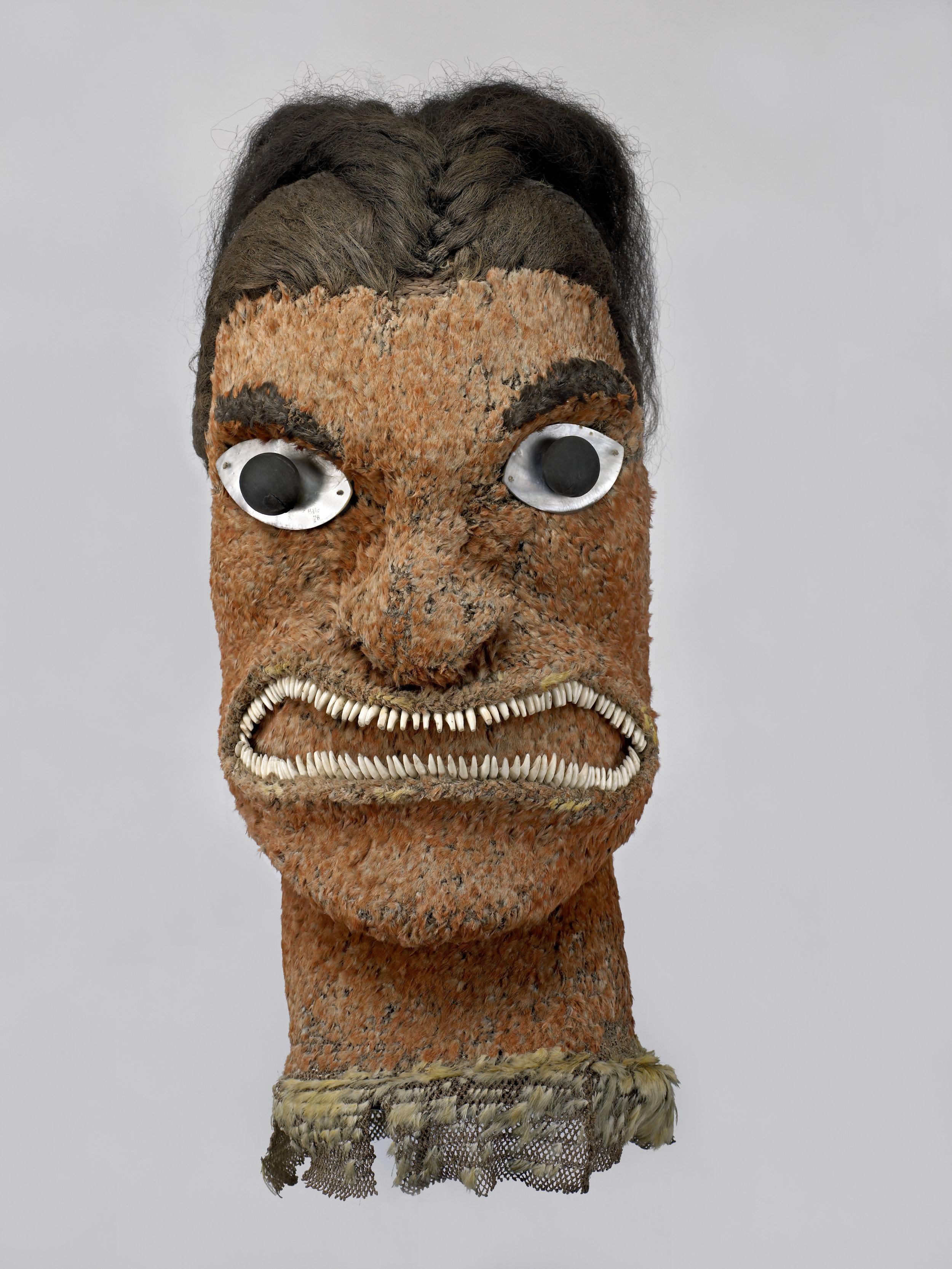 Feather god image (akua hulu manu), Late 18th century, Hawaiian Islands. Fibre, feathers, human hair, pearl shell, seed, dog teeth, 62 x 30 cm. (PHOTO: The Trustees of the British Museum)