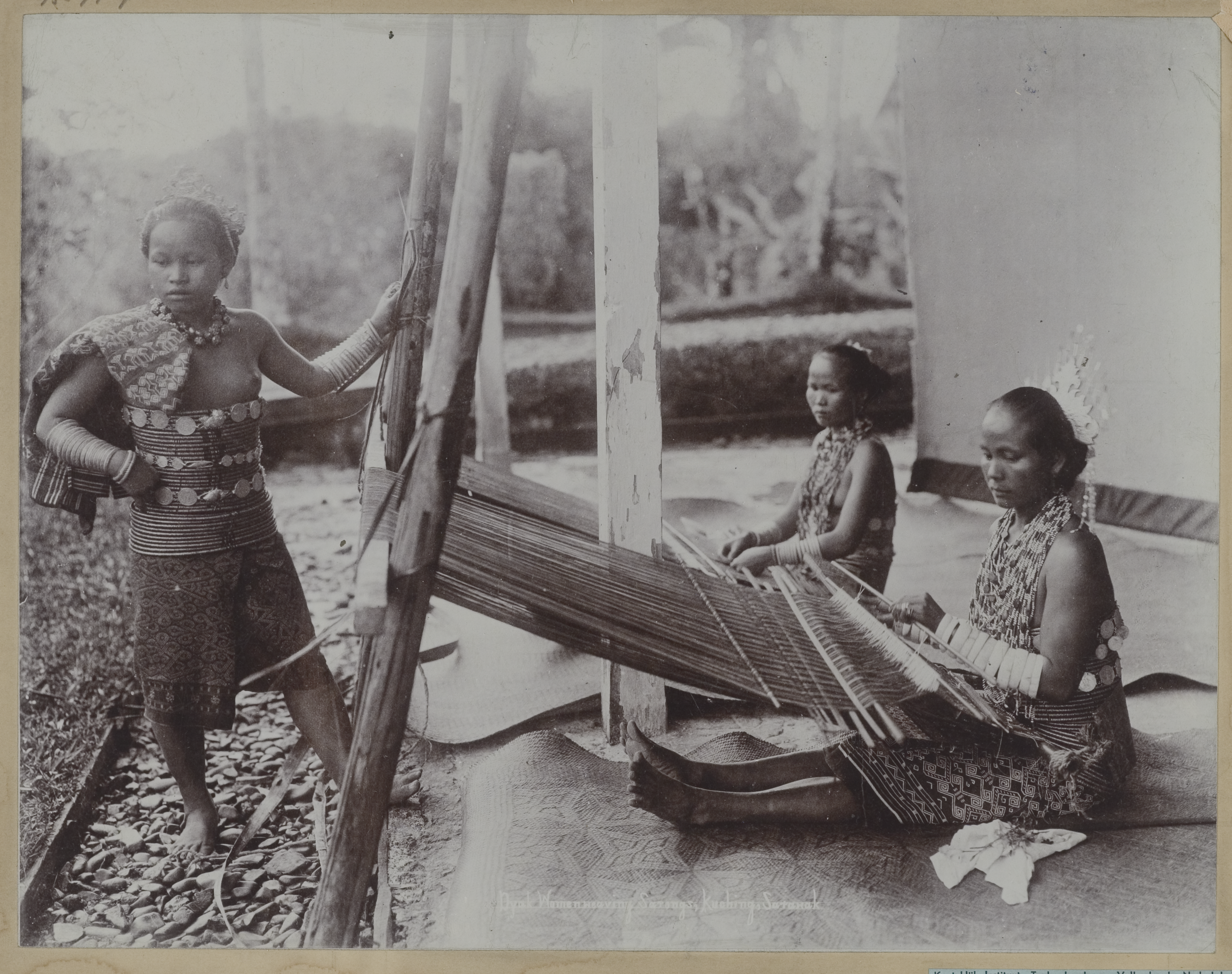 Dayak Female Weavers at Kuching circa 1900 © KITLV   Lambert & Co.