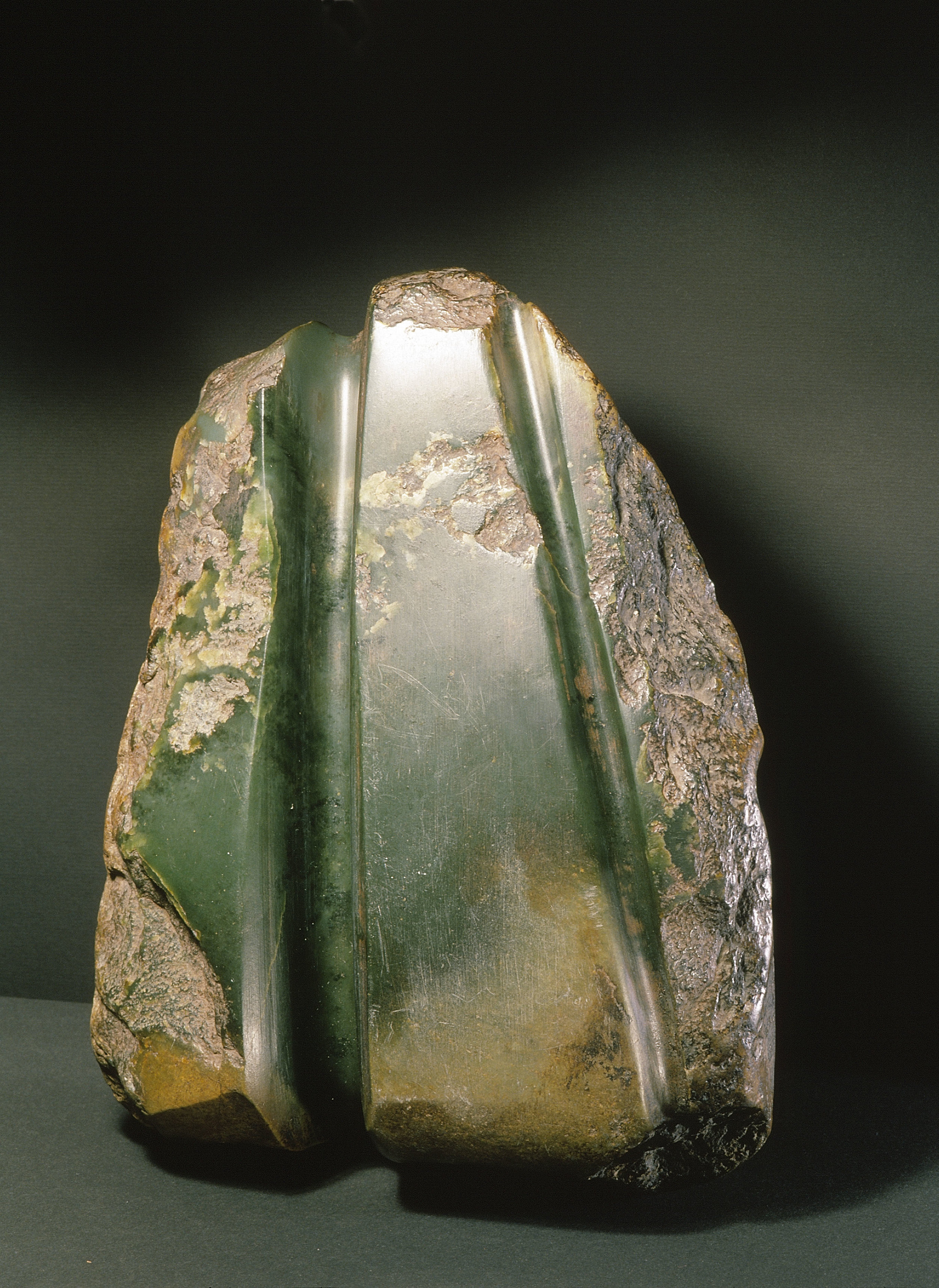 A partially cut out adze blade for a tokipoutangata, or chief's ceremonial axe, from nephrite jade.   19th century   Inv. #: 55405008 © Werner Forman Archive/ Canterbury Museum, Christchurch