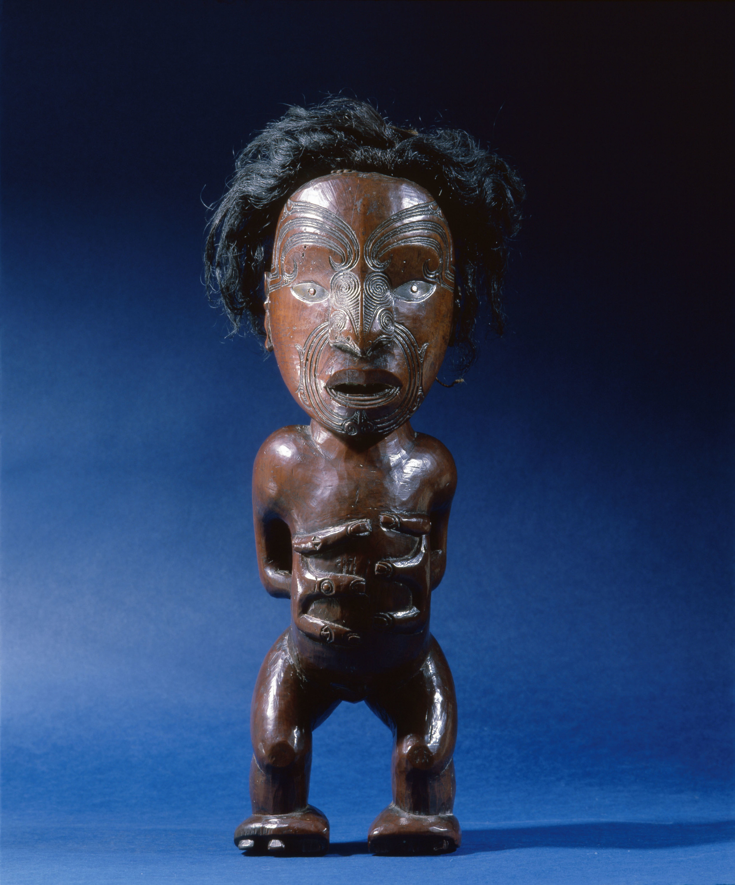 Carved wooden human figure with inlaid metal eyes and human hair. Although it is probably a depiction of a recent ancestor it's precise function is unknown. | Pre-1820. | Inv. #: 55407000 © Werner Forman Archive / Courtesy of Entwistle Gallery, London.