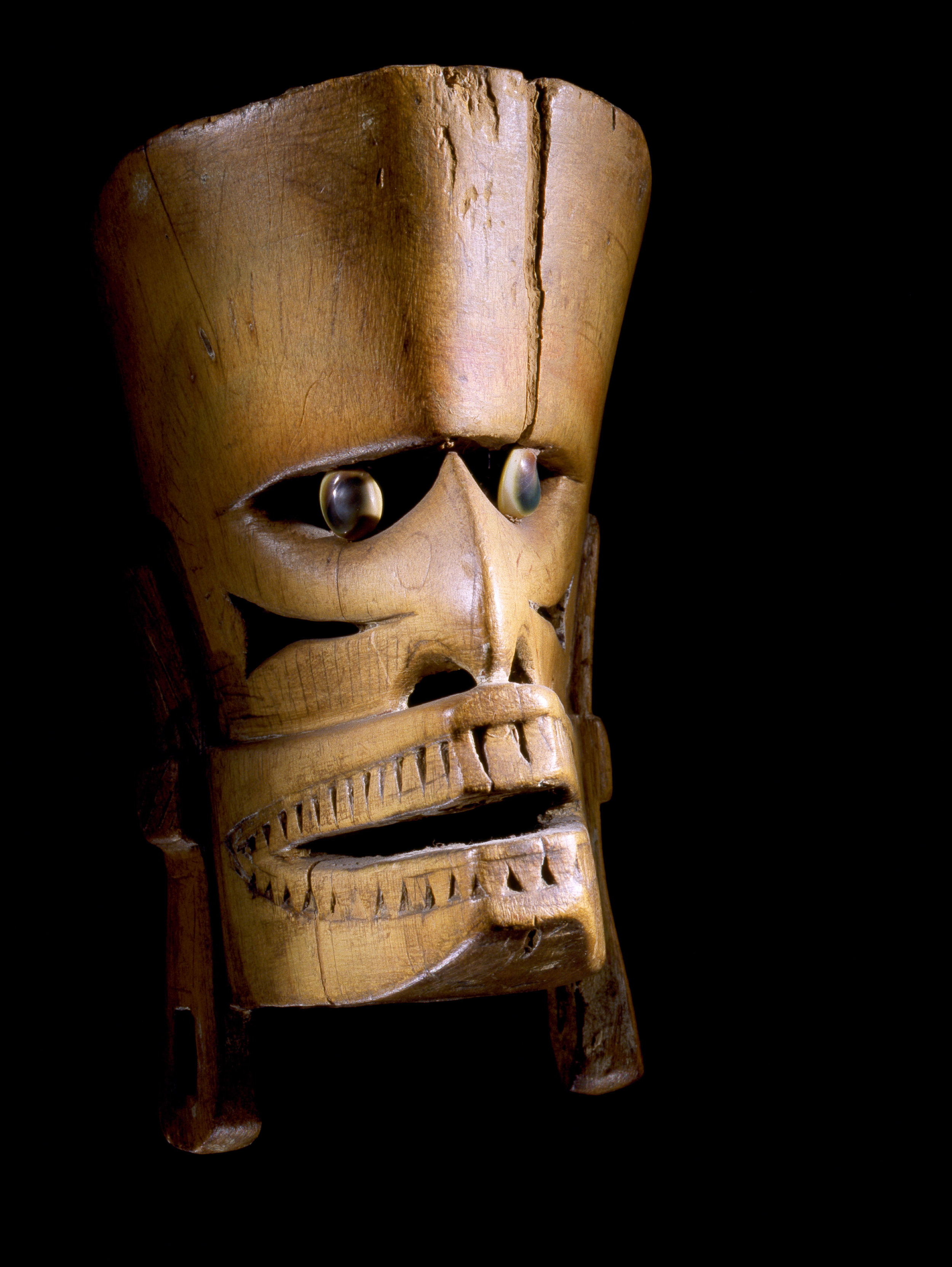 New Ireland mask (stripped of pigment) with snail operculae eyes. Papue New Guinea Location 01 Credit Line: Werner Forman Archive/ Private Collection. Courtesy Entwistle Gallery.
