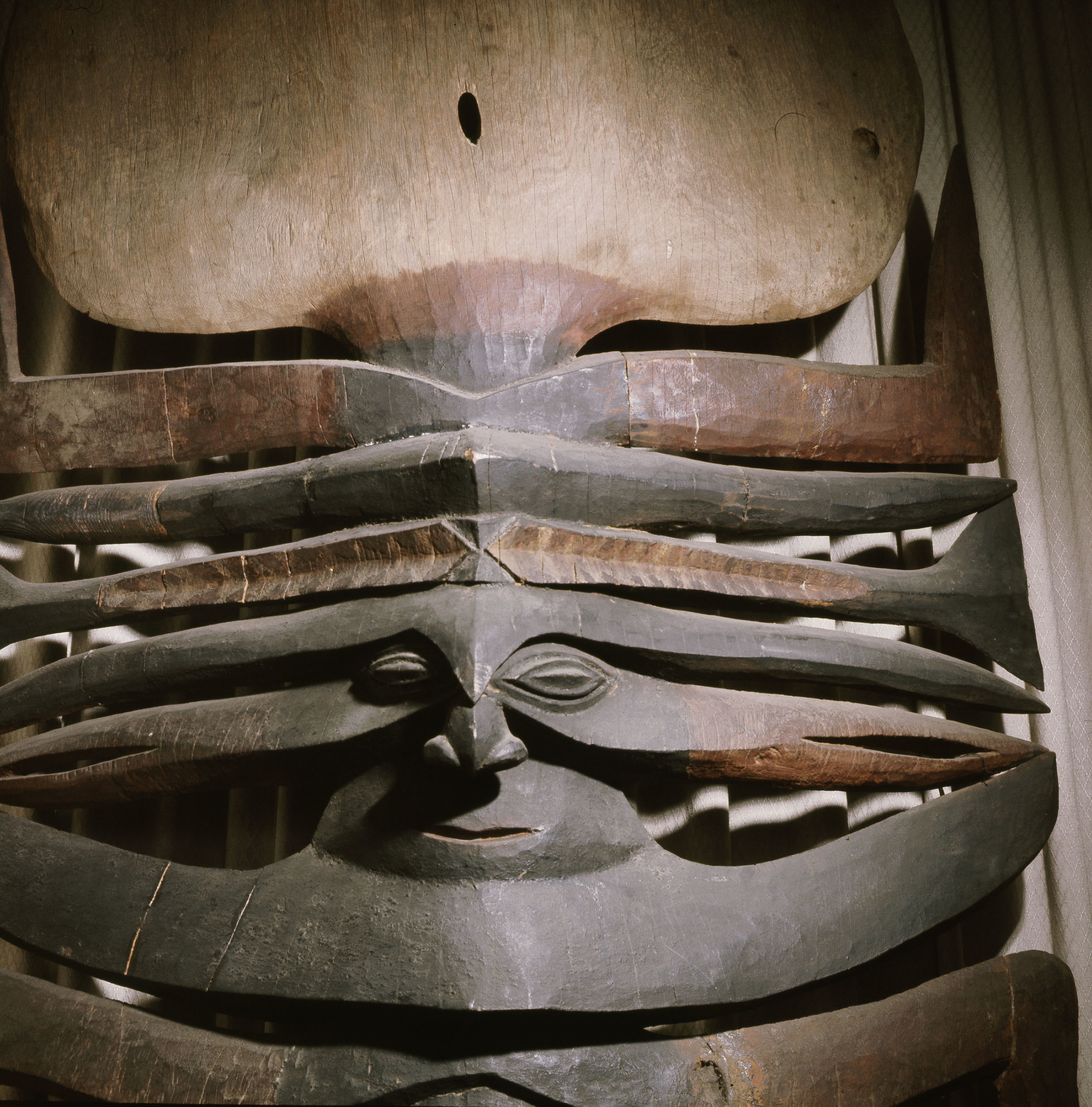 Detail of a carving from a men's meeting house. New Caledonian carving employed a complex form of split representation where details of the head are separated into flat segments and the rear of the head is spread out above the face. Country of Origin: New Caledonia. Material Size: Wood. Credit Line: Werner Forman Archive/ Museum fur Volkerkunde, Vienna.