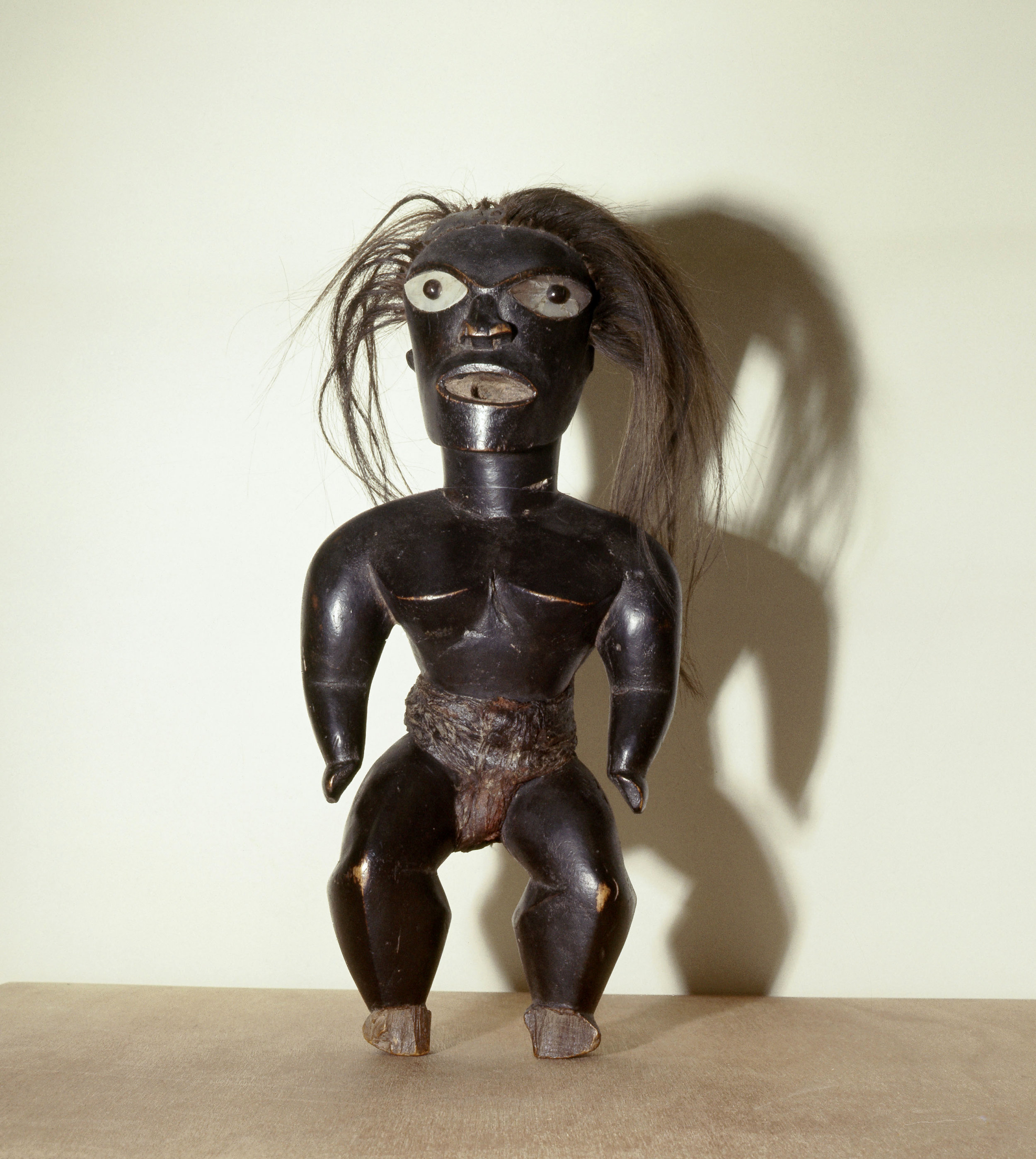 Statue of Pele, the Hawaiian fire goddess, a malign force who lives in the crater of Kilauea volcano. Country of Origin: Hawaii. Culture: Polynesia. Date/Period: 17th - 18th C. Material Size: Wood, hair. Credit Line: Werner Forman Archive / British Museum, London.