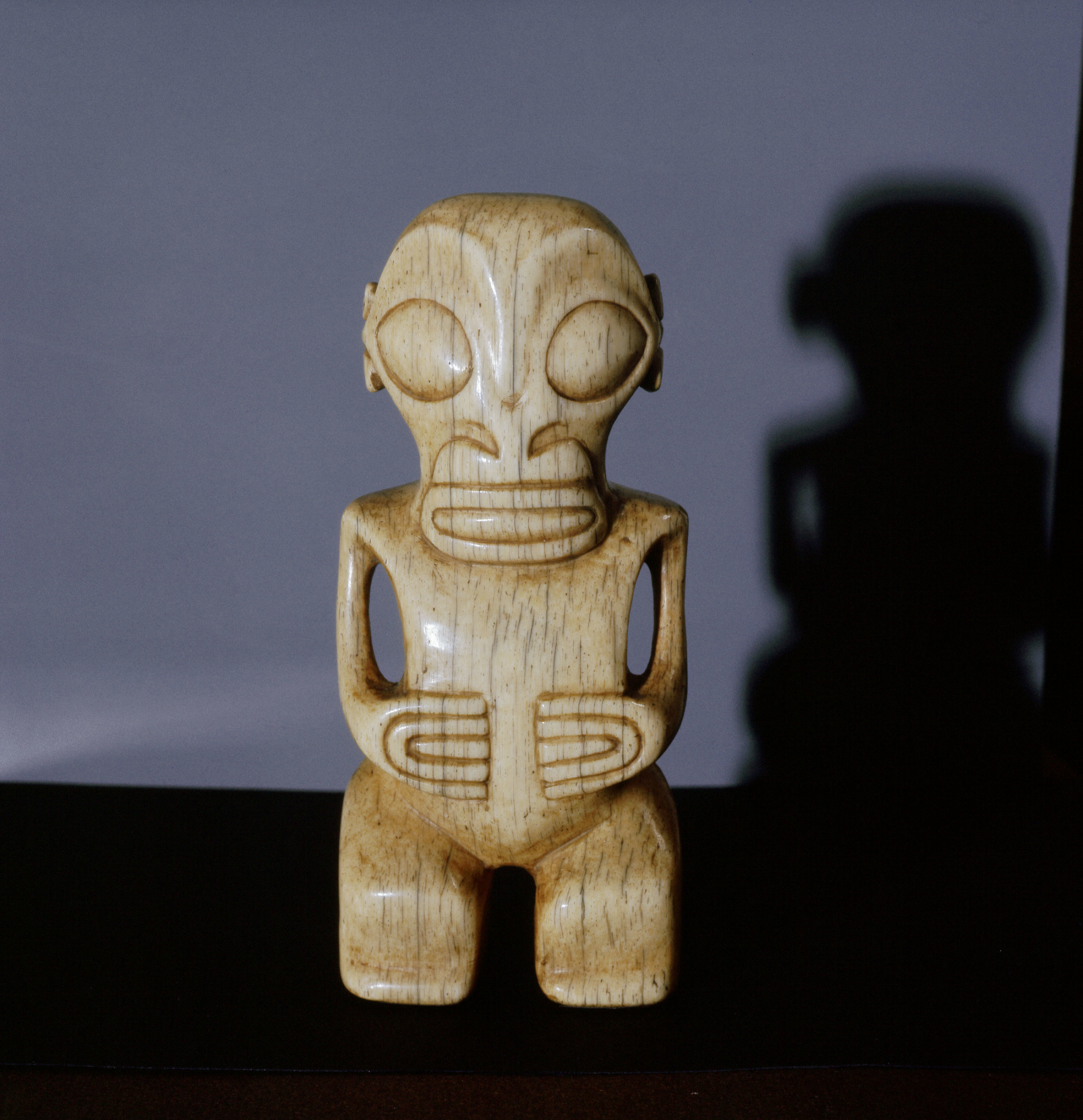 Small ivory tiki figure, probably a pendant. Country of Origin: Marquesas Islands. Culture: Oceanic. Material Size: Sea mammal ivory. Credit Line: Werner Forman Archive / Private Collection.