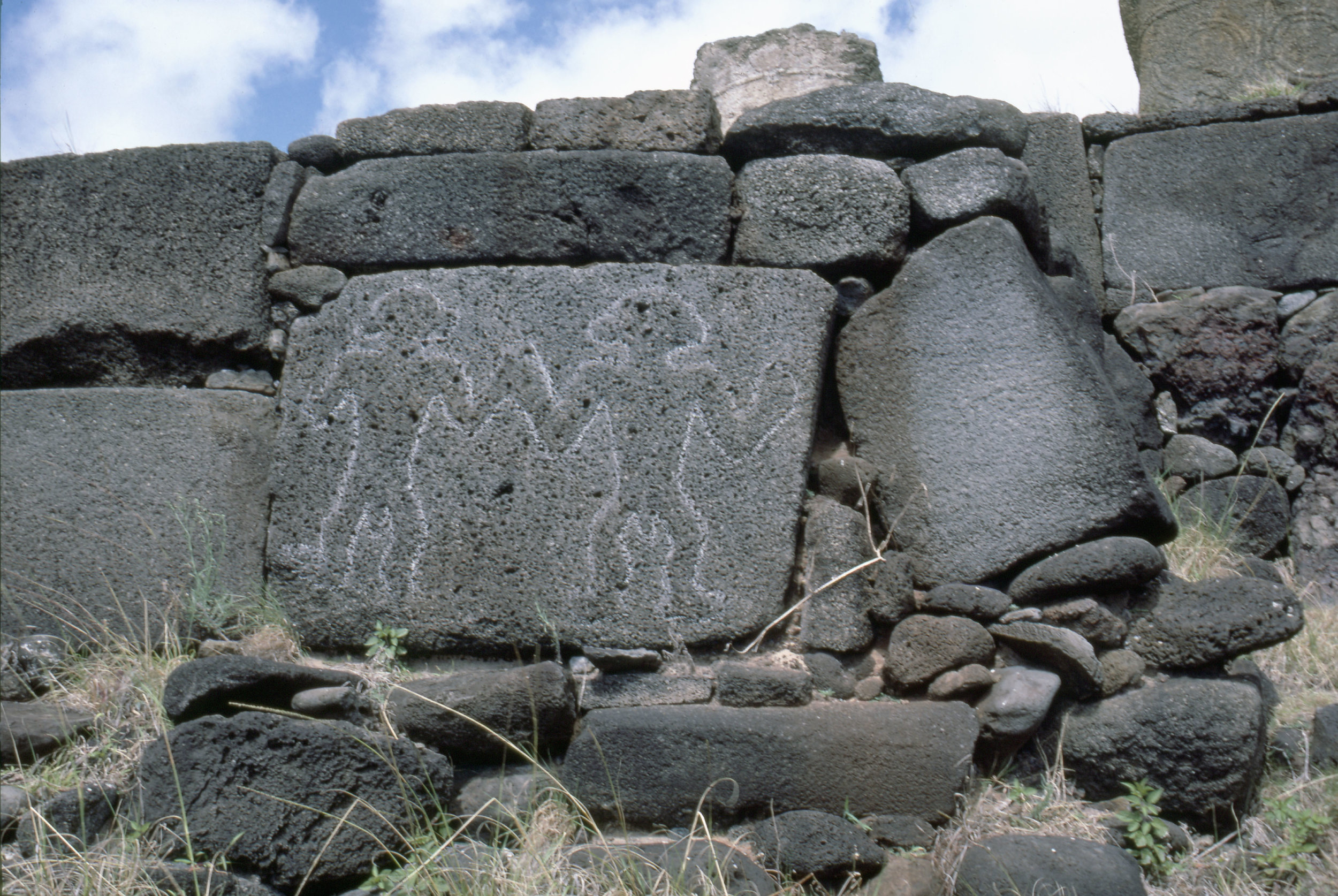 Petroglyphs of two men carved on stone slab, forming part of the foundations for the re-erected Moai platform at Anakena Bay. Country of Origin: Easter Island. Culture: Oceanic. Place of Origin: Easter Island. Credit Line: N.J Saunders / Werner Forman Archive.