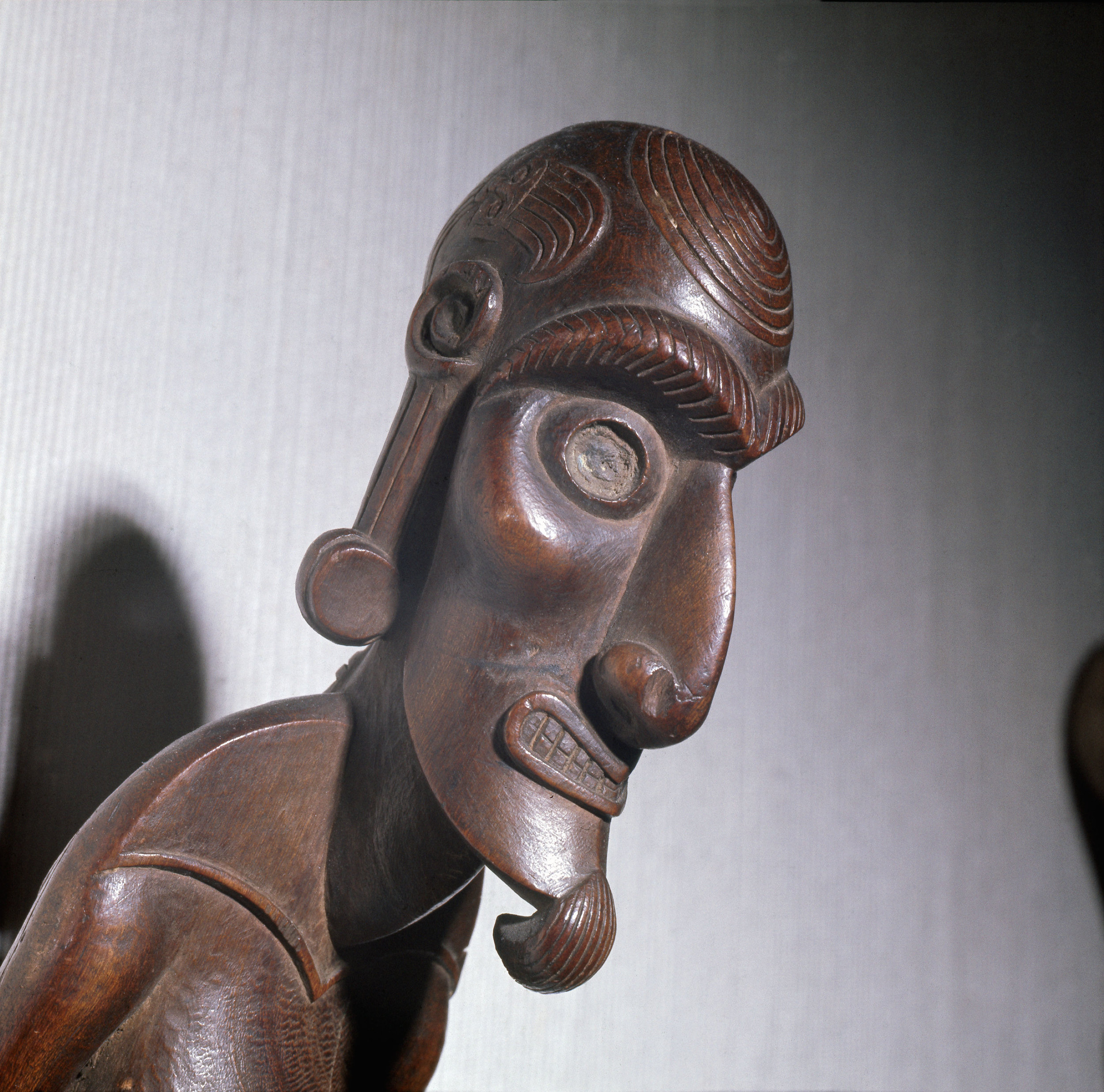 An ancestral figure known as a 'moai kavakava', emaciated man, worn hung onto its owner at dances and feasts. The more a man wore, sometimes as many as ten or twenty, the more likely were the gods to grant his requests. Country of Origin: Easter Island. Culture: Oceanic. Date/Period: 19th C. Material Size: Wood, h= 47cms. Credit Line: Werner Forman Archive / British Museum, London.
