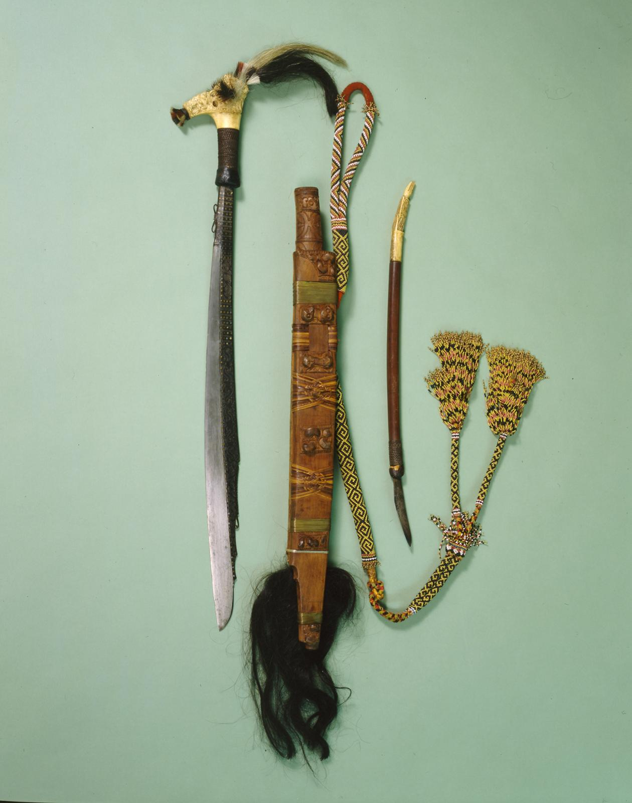 Sword   Mandau   Gift of Dr. William H. Furness 3rd, 1898   Object #: P1232A   Penn Museum