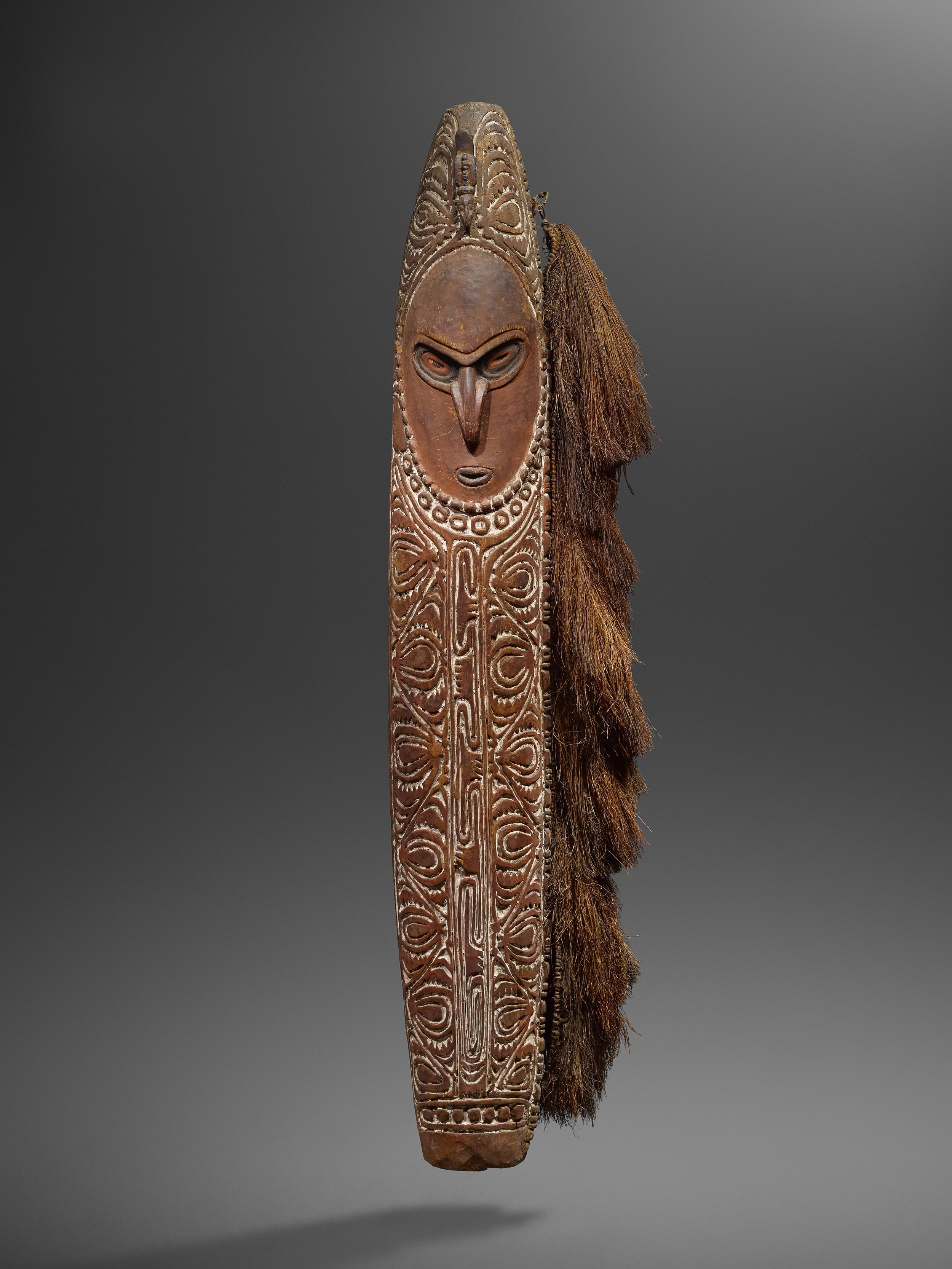 Shield. Lower Sepik or Ramu. Wood, fibre and pigments. 154 cm. Hermann Seeger, Stuttgart. © Hugues Dubois, Brussels/Paris