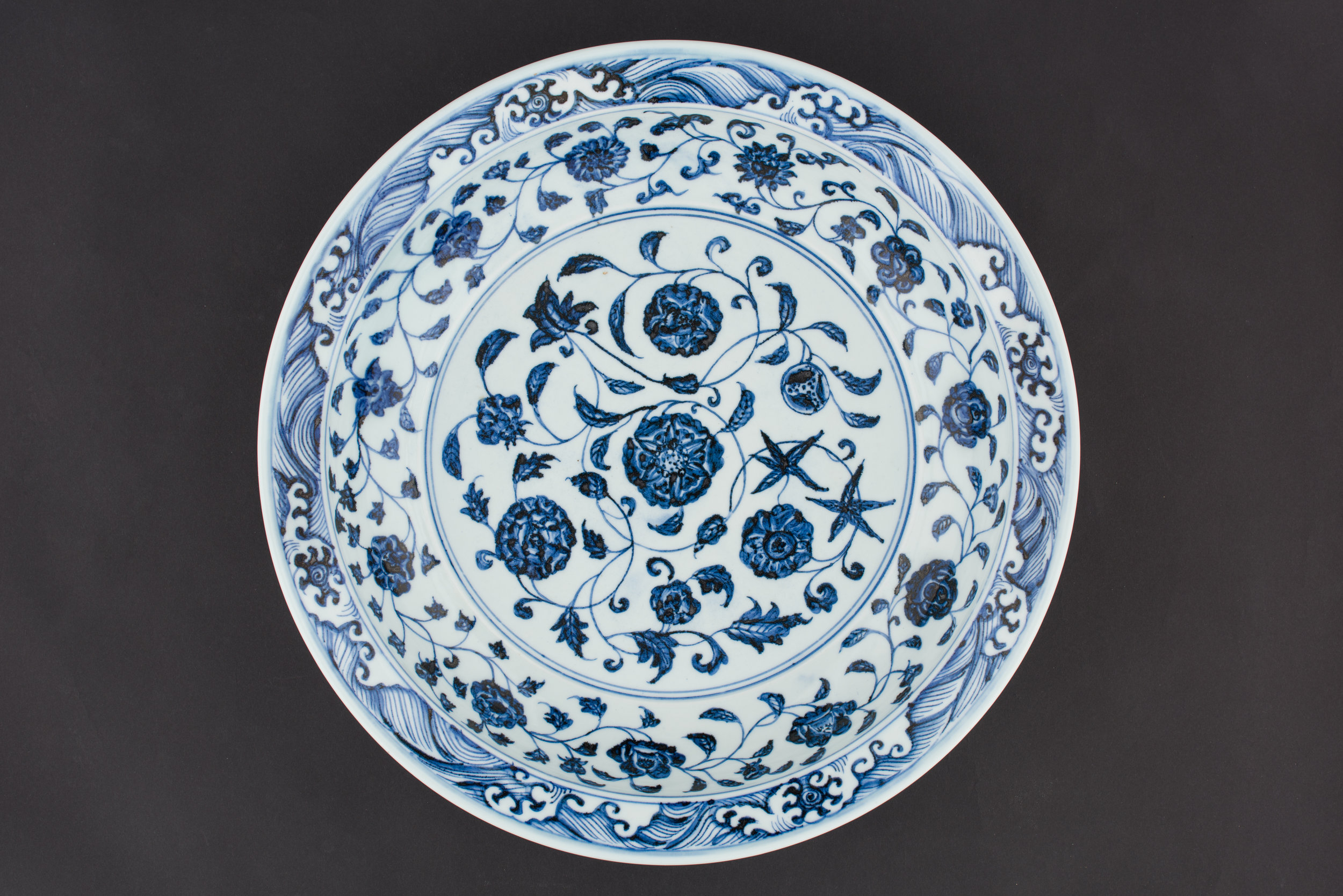 Dish.  China, Jingdezhen, Ming dynasty (Yongle period, 1403–24). Porcelain, 7.5 x 40 cm Asian Civilisations Museum; Gift of Mr Saiman Ernawan. Image courtesy of Asian Civilisations Museum.