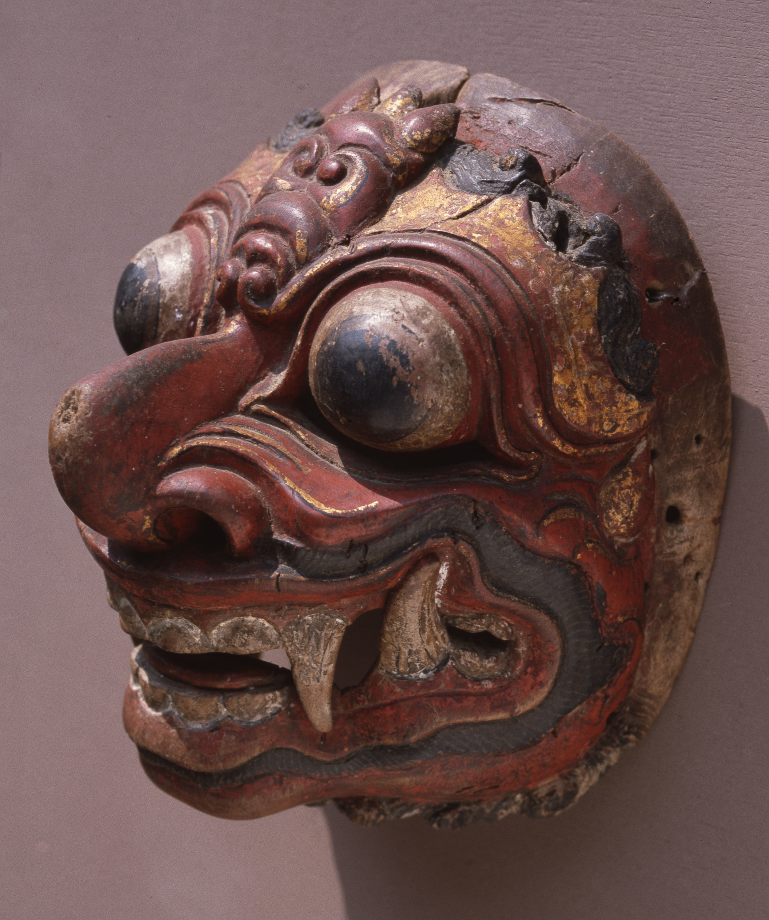 A mask representing a demon, used in wayang wong performances of the Hindu epics, especially the Ramayana. Country of Origin: Indonesia. Culture: Balinese. Date/Period: 1982 Place of Origin: Bali. Material Size: Wood, paint, fabric, metal. Credit Line: Werner Forman Archive/Denpasar Museum, Bali.