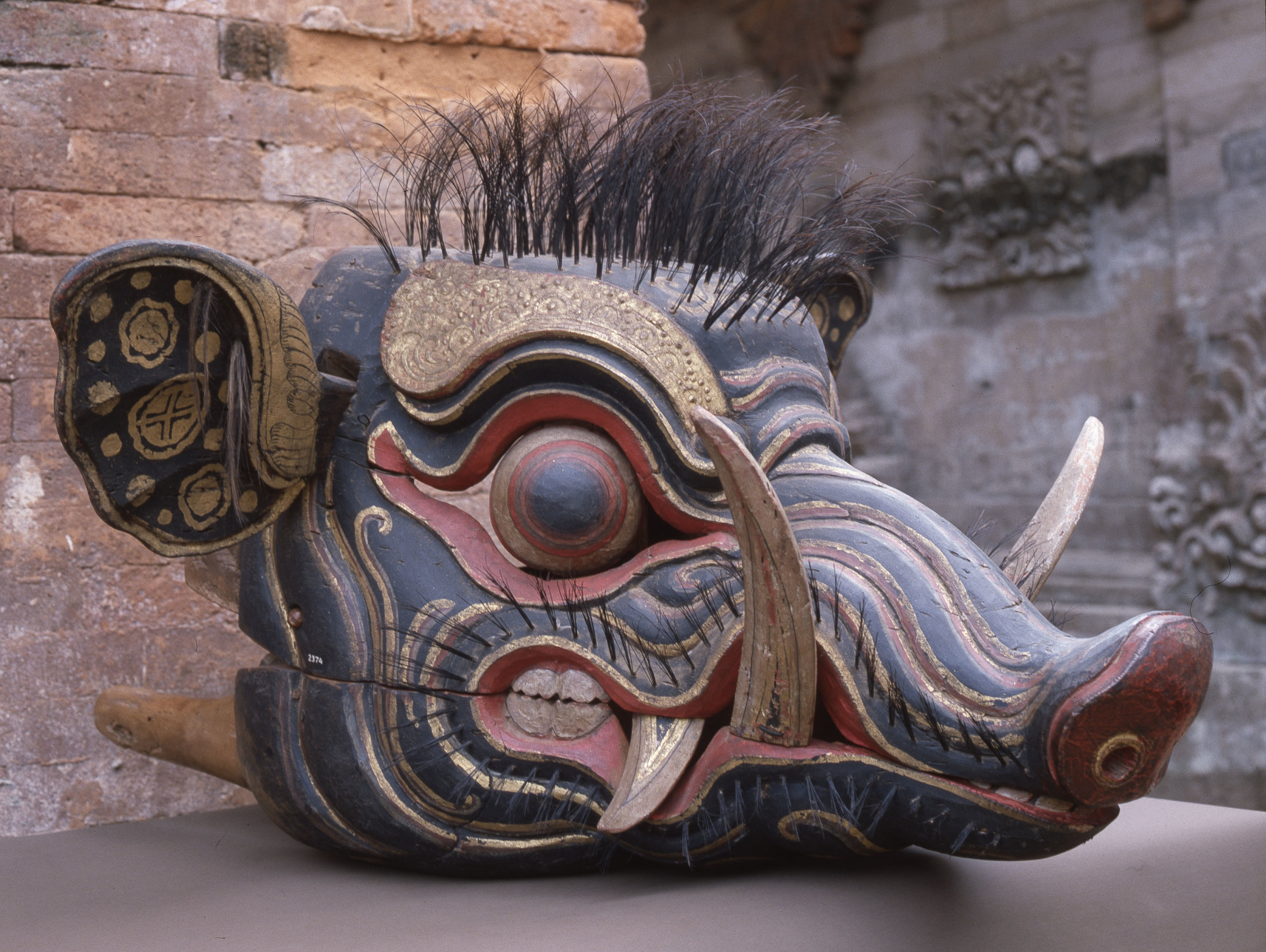 Barong Bangkung, a boar's head variant of the Barong dance mask. Country of Origin: Indonesia. Culture: Balinese. Date/Period: 1982 Place of Origin: Bali. Material Size: Wood, paint, fabric, metal. Credit Line: Werner Forman Archive.