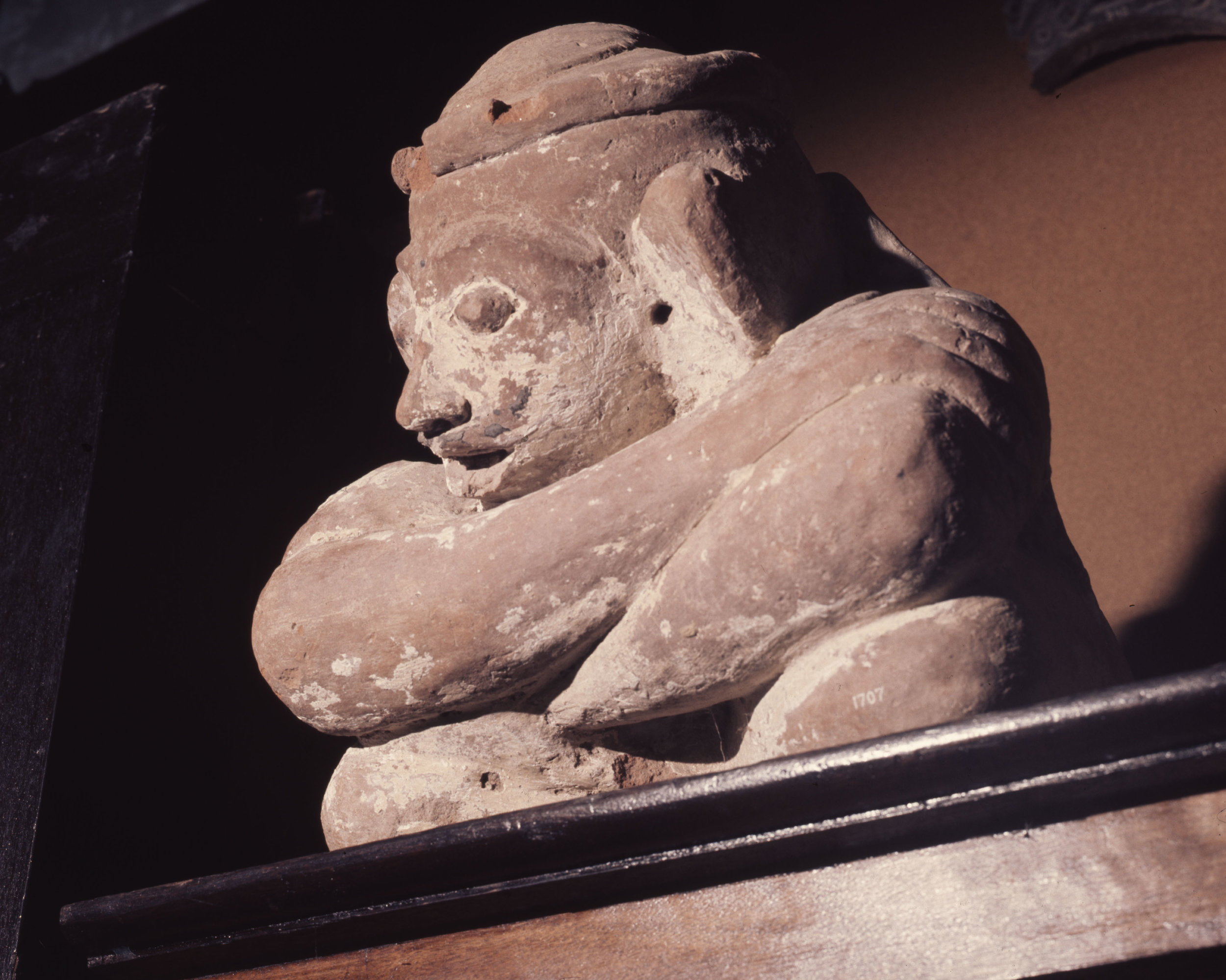 Stone sculpture of a seated man. Country of Origin: Indonesia. Culture: Balinese. Place of Origin: Bali. Material Size: Stone. Credit Line: Werner Forman Archive.