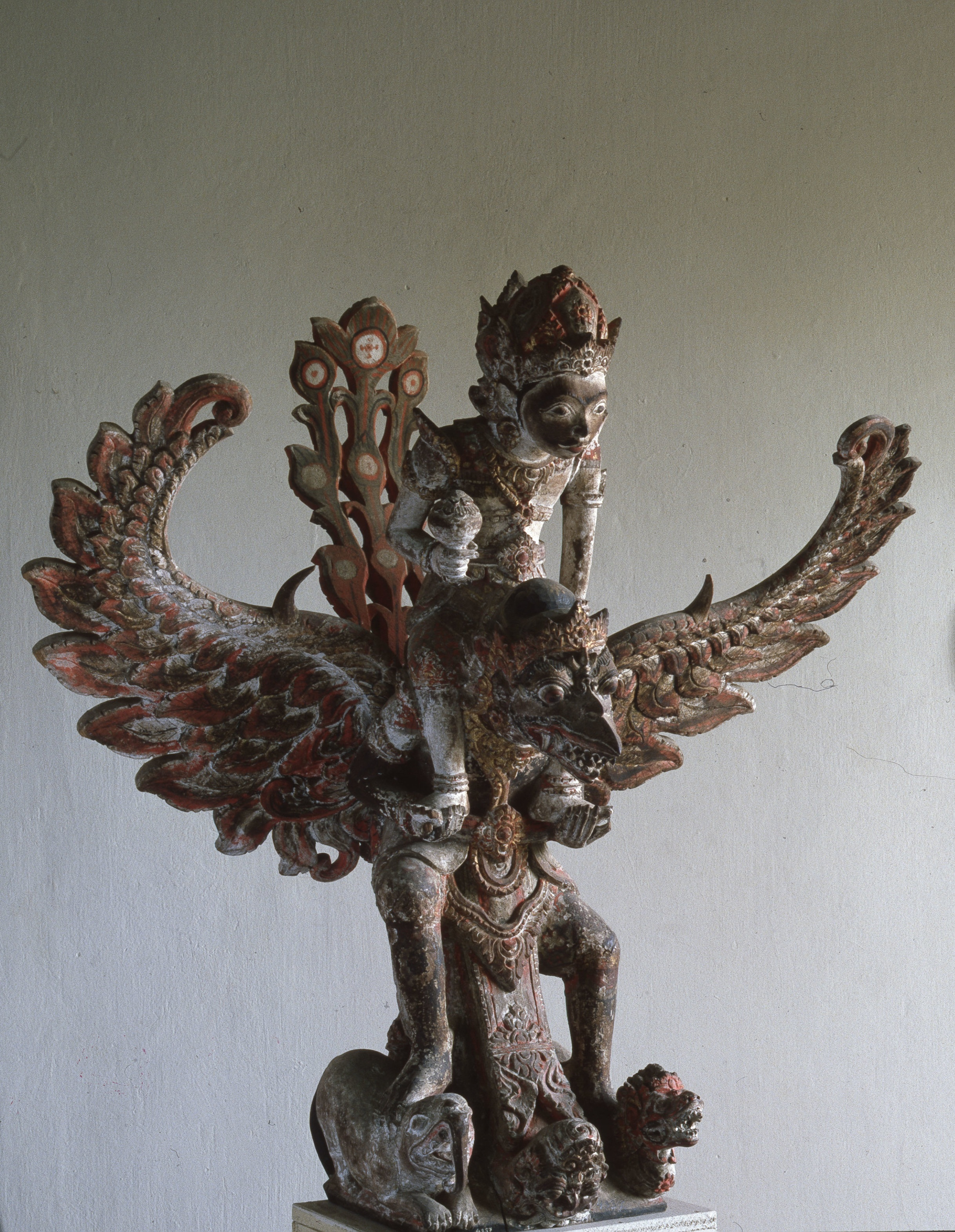 Vishnu (Wisnu) on his mount Garuda. A pillar base once mounted in the centre of the ridge-pole, high up under the roof of a pavilion. Country of Origin: Bali, Indonesia. Culture: Hindu. Credit Line: Werner Forman Archive/Denpasar Museum.