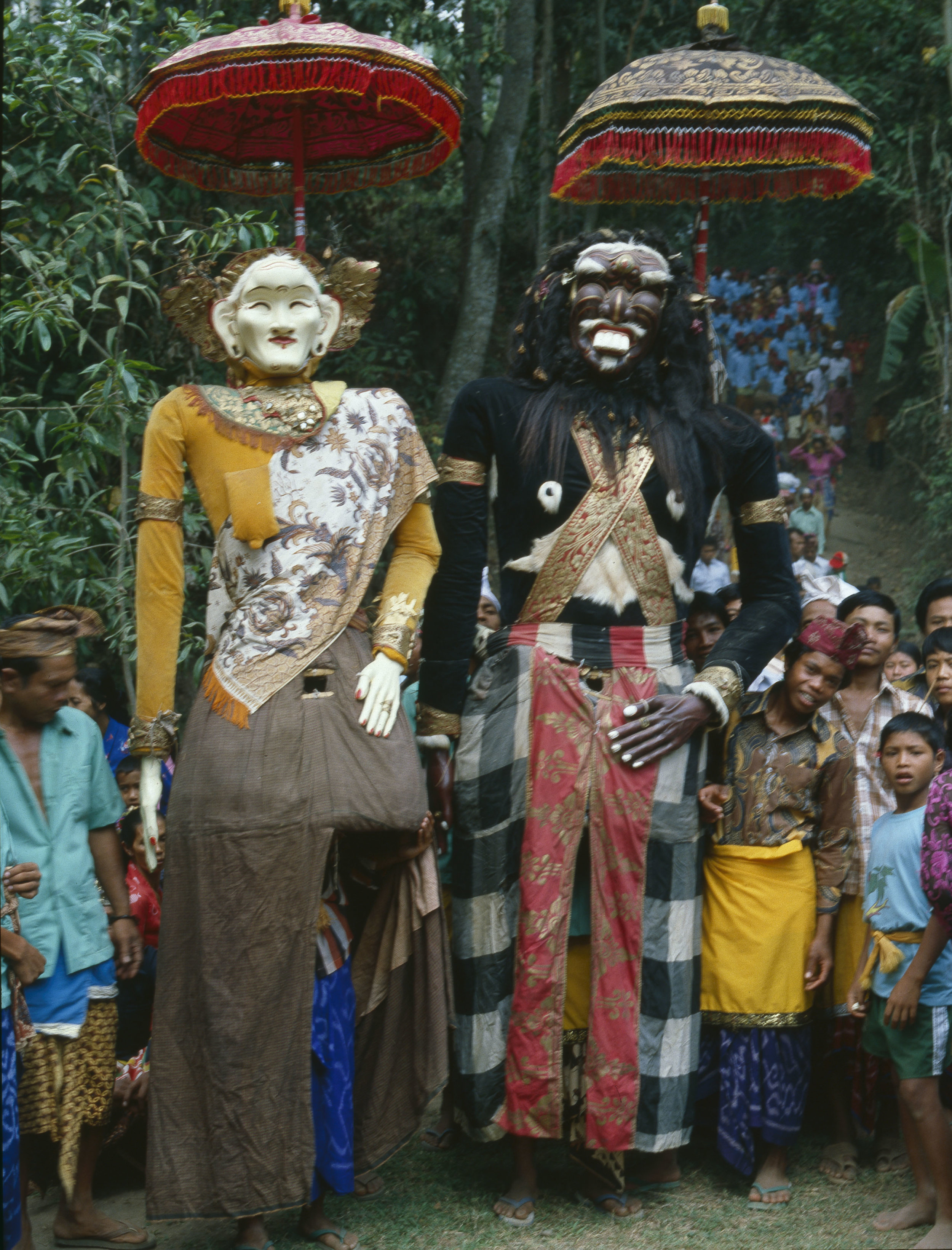 The Balinese version of Hinduism has an elaborate calender of festivals associated with each major temple. Here the Barong Landung, revered as deities, return from a symbolic bath. The black giant is Jero Gede , the Big One, and his companion is Jero Luh, the Female. Country of Origin: Indonesia. Culture: Balinese. Date/Period: 1982. Place of Origin: Bali. Credit Line: Werner Forman Archive.