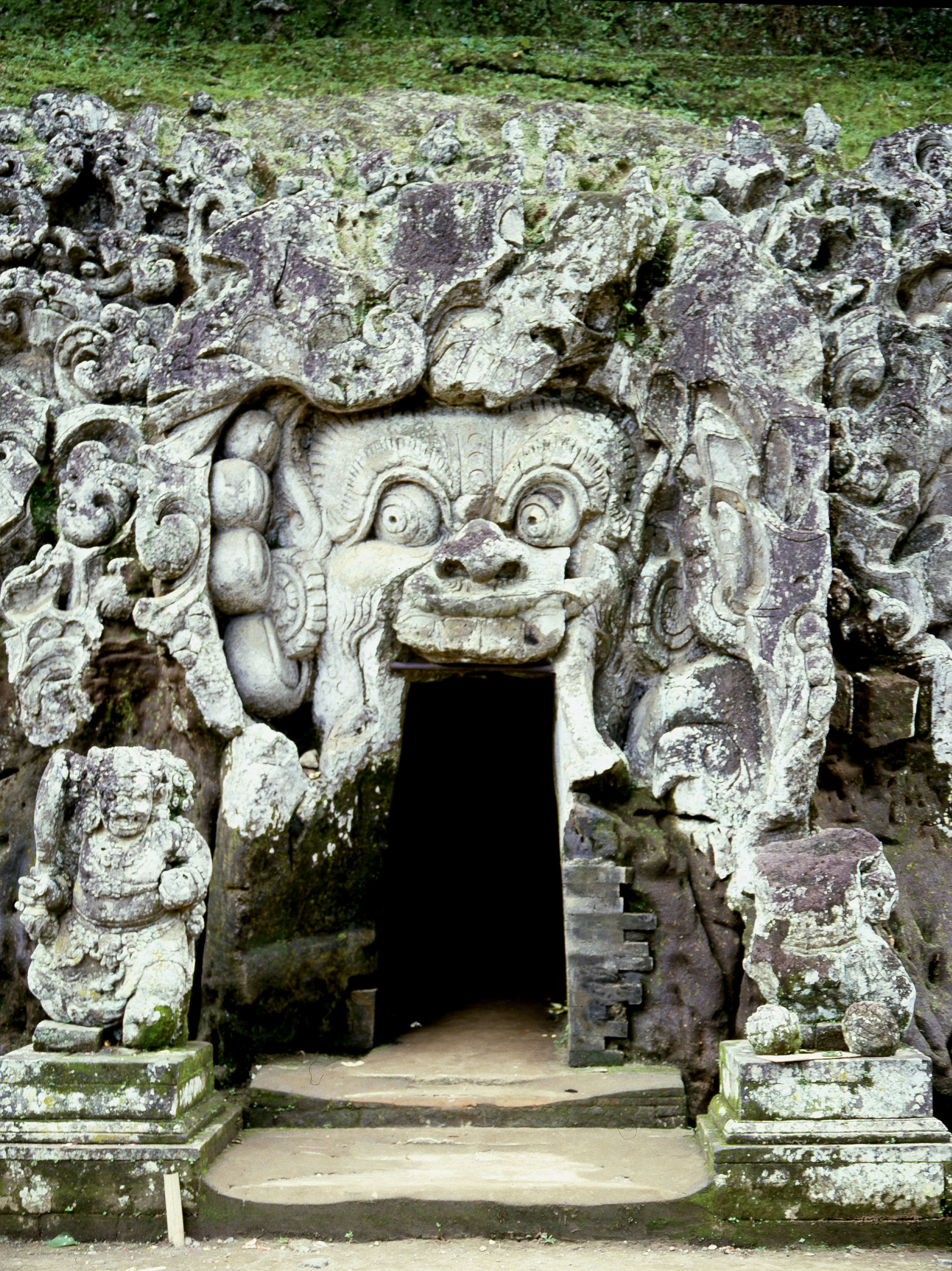 The Goa Gajah, Elephant Cave, near Bedulu. Demons guard the entrance to a cave once used as a hermitage by Siwaite monks. The demons are interpreted as a symbol of human impotence in the face of the forces of nature. Country of Origin: Indonesia. Culture: Balinese/Hindu. Date/Period: 11th Century. Place of Origin: Bedulu, Bali. Credit Line: Werner Forman Archive.