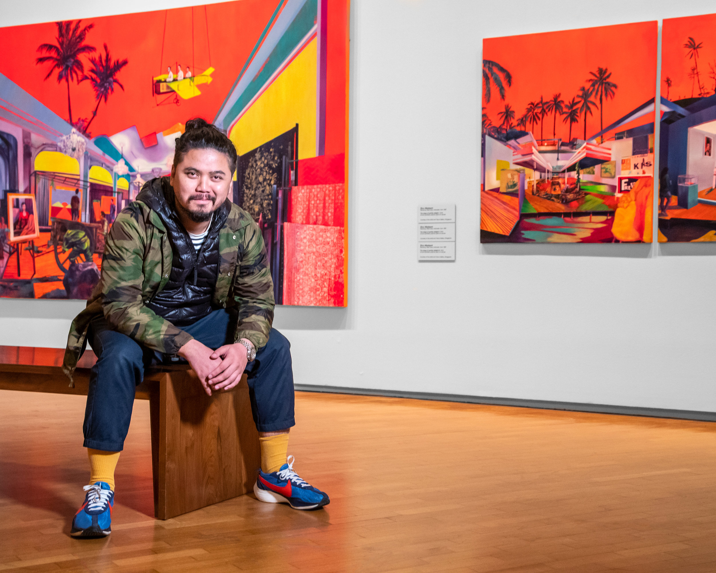 Artist  Zico Albaiquni  with his works  Ladies and gentlemen! Kami present, Ibu Pertiwi!  (2018) and  The stage of earthly delight I  (2018)