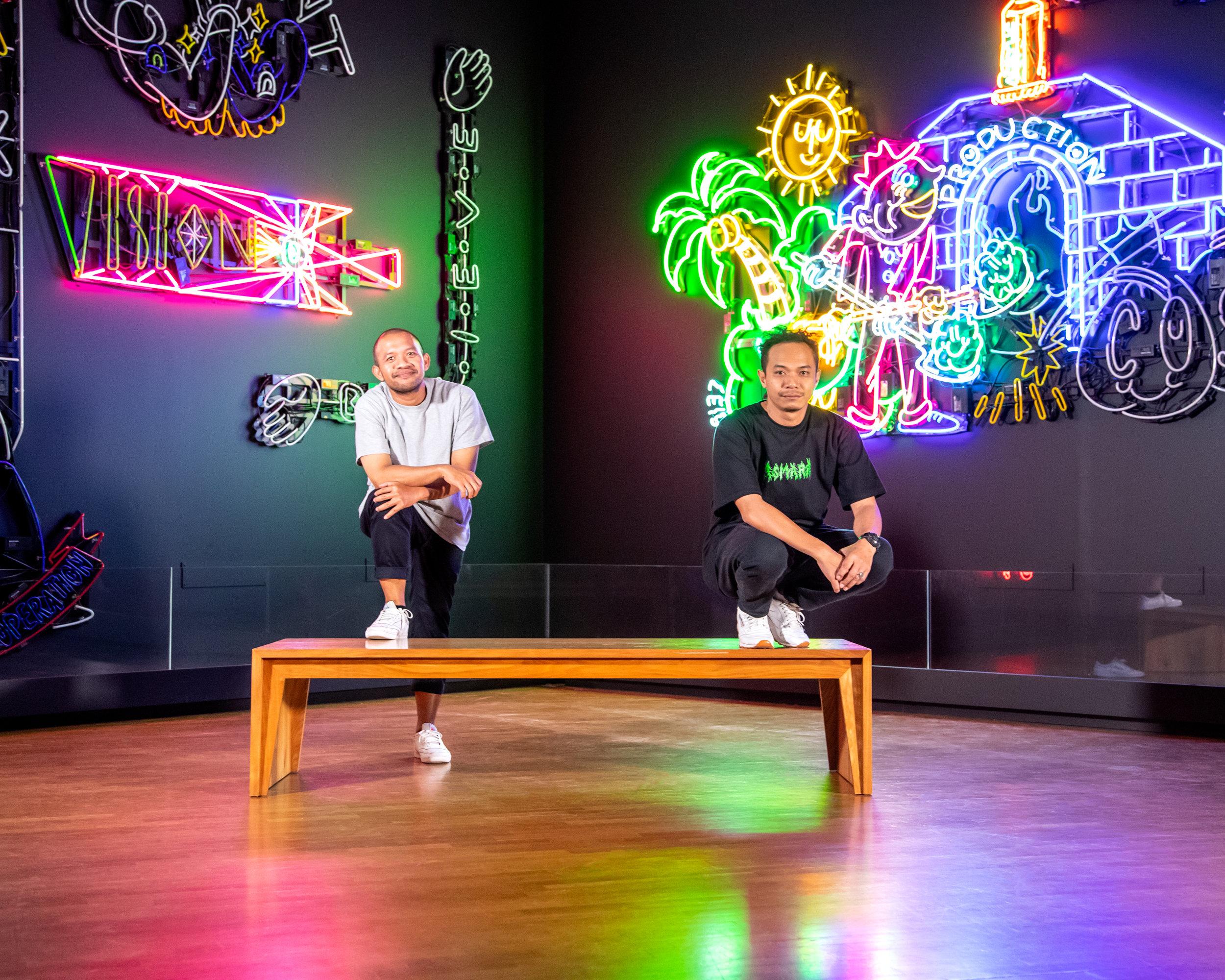 Artist  Uji 'Hahan' Handoko Eko Saputro  and  Adi 'Uma Gumma' Kusama  with their work  Silent Operation: Sign study based on the formula of contemporary (visual) art  (2018-19)