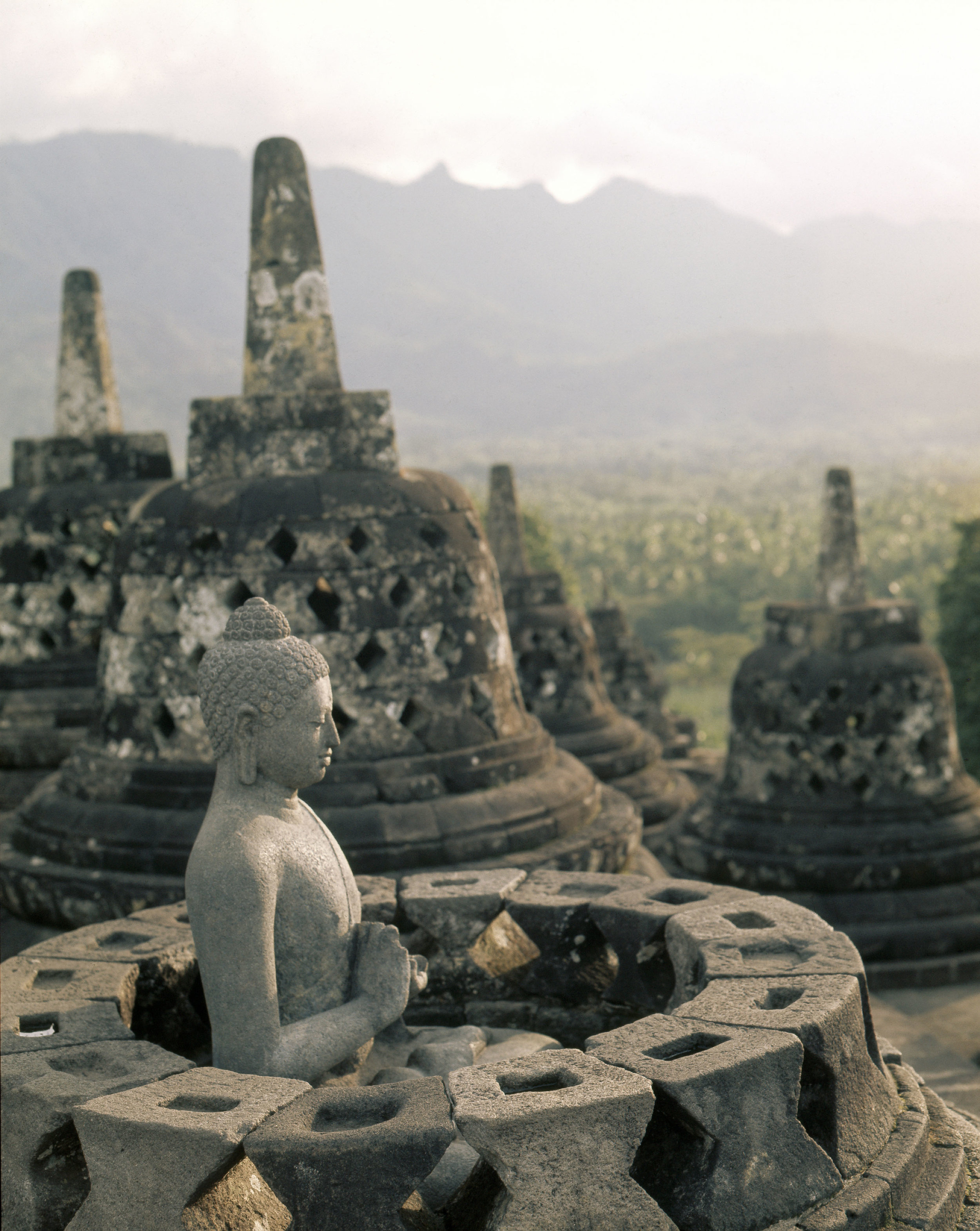 The circular terraces, Borobudur. Each stupa houses a figure of the Dhyani-Buddha Vajrasattva in the attitude of preaching. Country of Origin: Indonesia. Culture: Buddhist. Date/Period: 8th C. Place of Origin: Central Java. Credit Line: Werner Forman Archive.