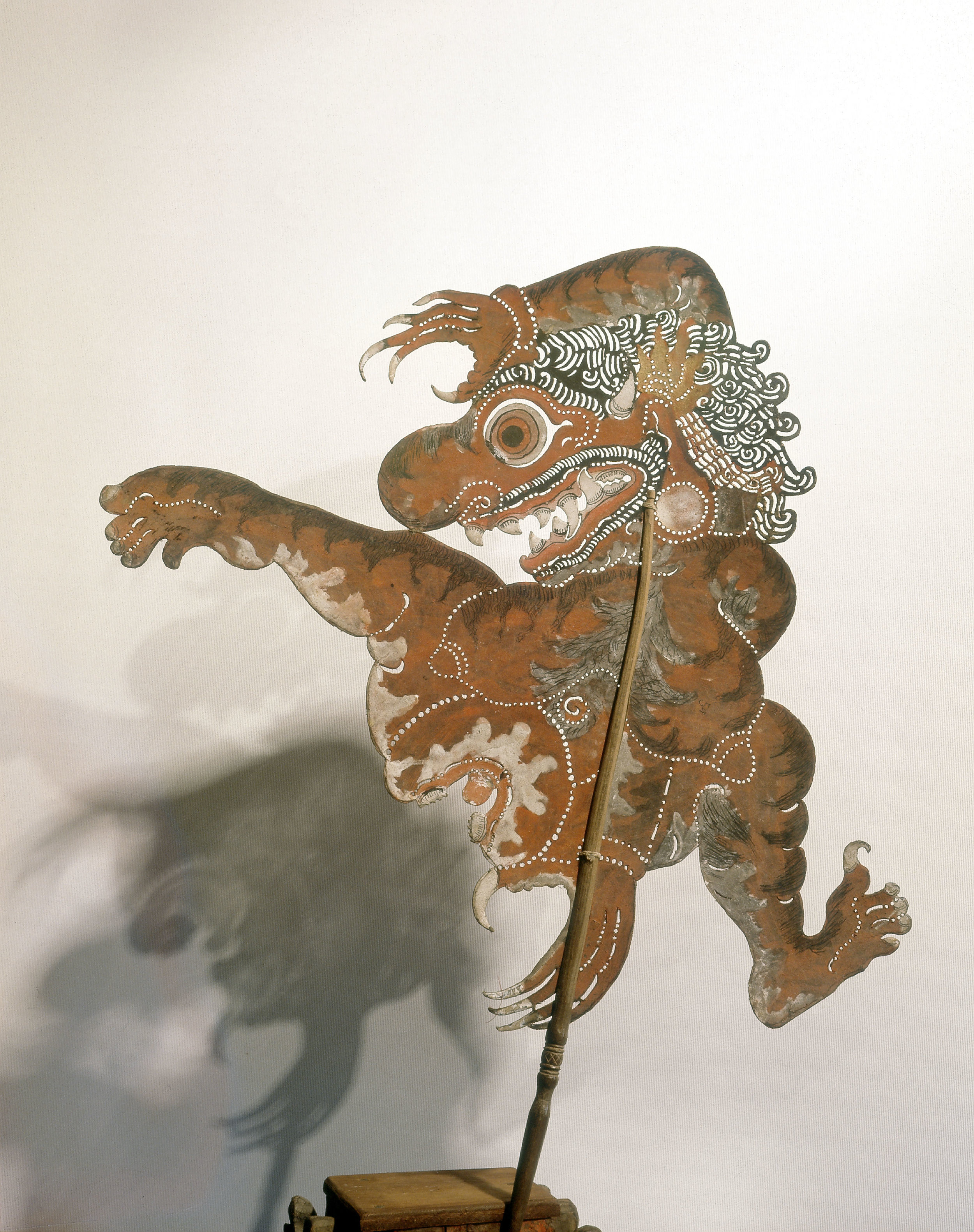 Wayang kulit shadow puppet used in popular all-night performances, usually based on ancient Hindu epics such as the Ramayana. Country of Origin: Indonesia. Culture: Javanese. Date/Period: c.1900. Place of Origin: Java. Material Size: Leather, wood, paint. Credit Line: Werner Forman Archive/Private Collection.