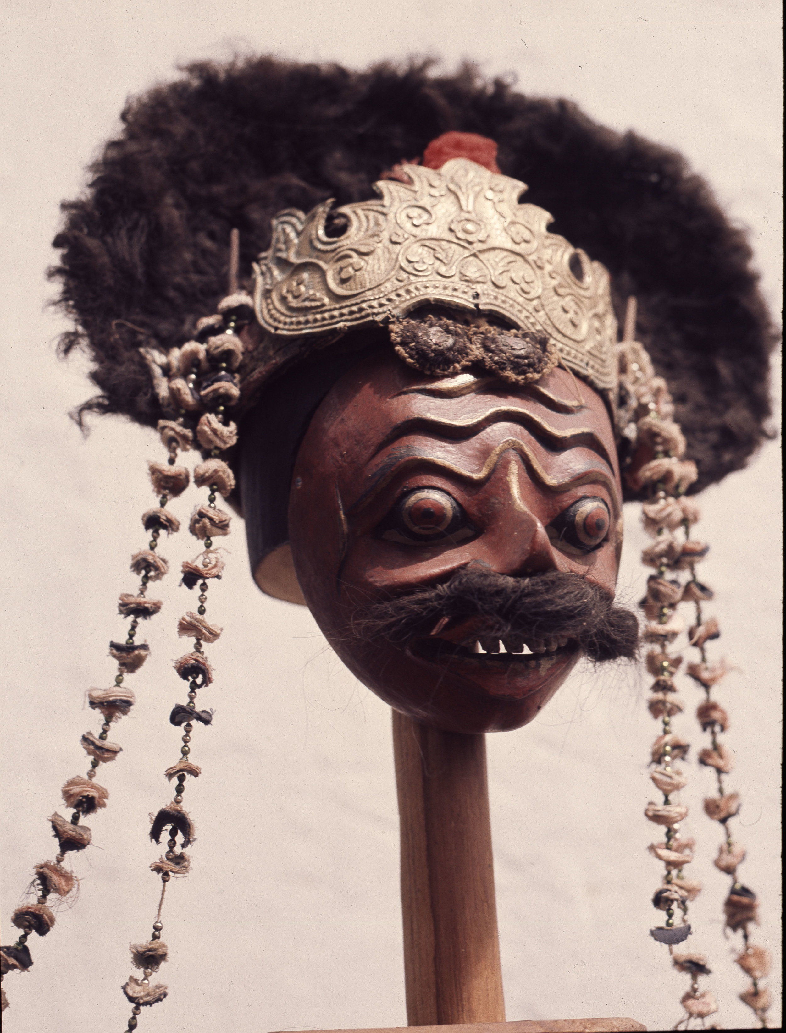 A mask used in wayang wong performances of the Hindu epics, especially the Ramayana. Wayang wong is still performed but is today less popular than shadow puppet wayang theatre. Country of Origin: Indonesia. Culture: Javanese. Date/Period: late 19th - 20th C. Place of Origin: Yogjakarta, Java. Material Size: Wood, paint, fabric, metal. Credit Line: Werner Forman Archive/Palace Museum, Yogjakarta.