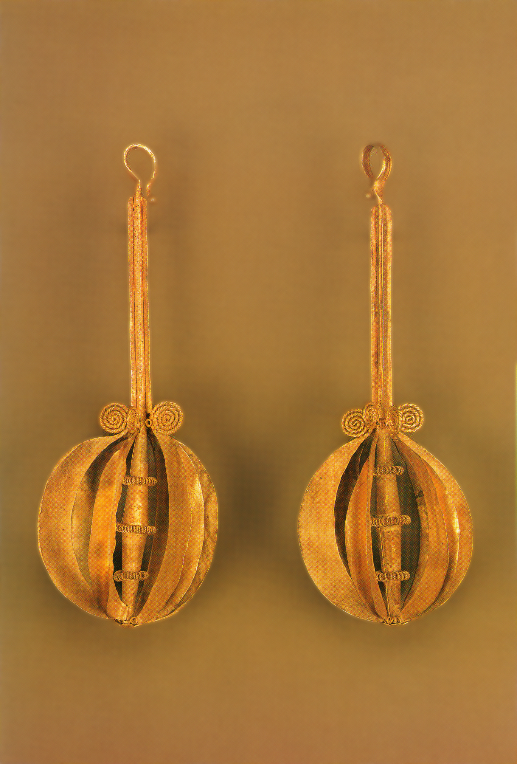 Pair of beautiful gold ear ornaments worn by noble women in South Nias. (Nias Tribal Treasures: plate 41, Delft 1990)