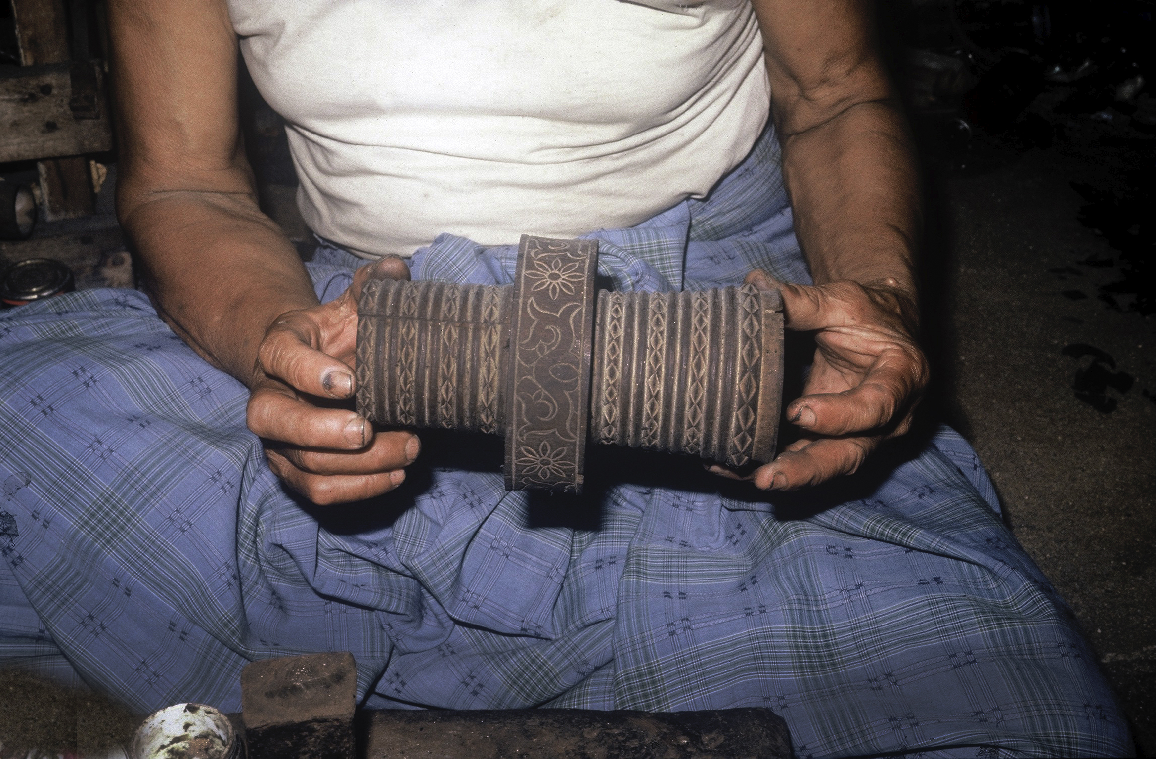 A wooden armband  töla jaga  with incised patterns. In earlier days covered with thin gold sheet, worn by women. (Photograph Maggie de Moor, 1985)