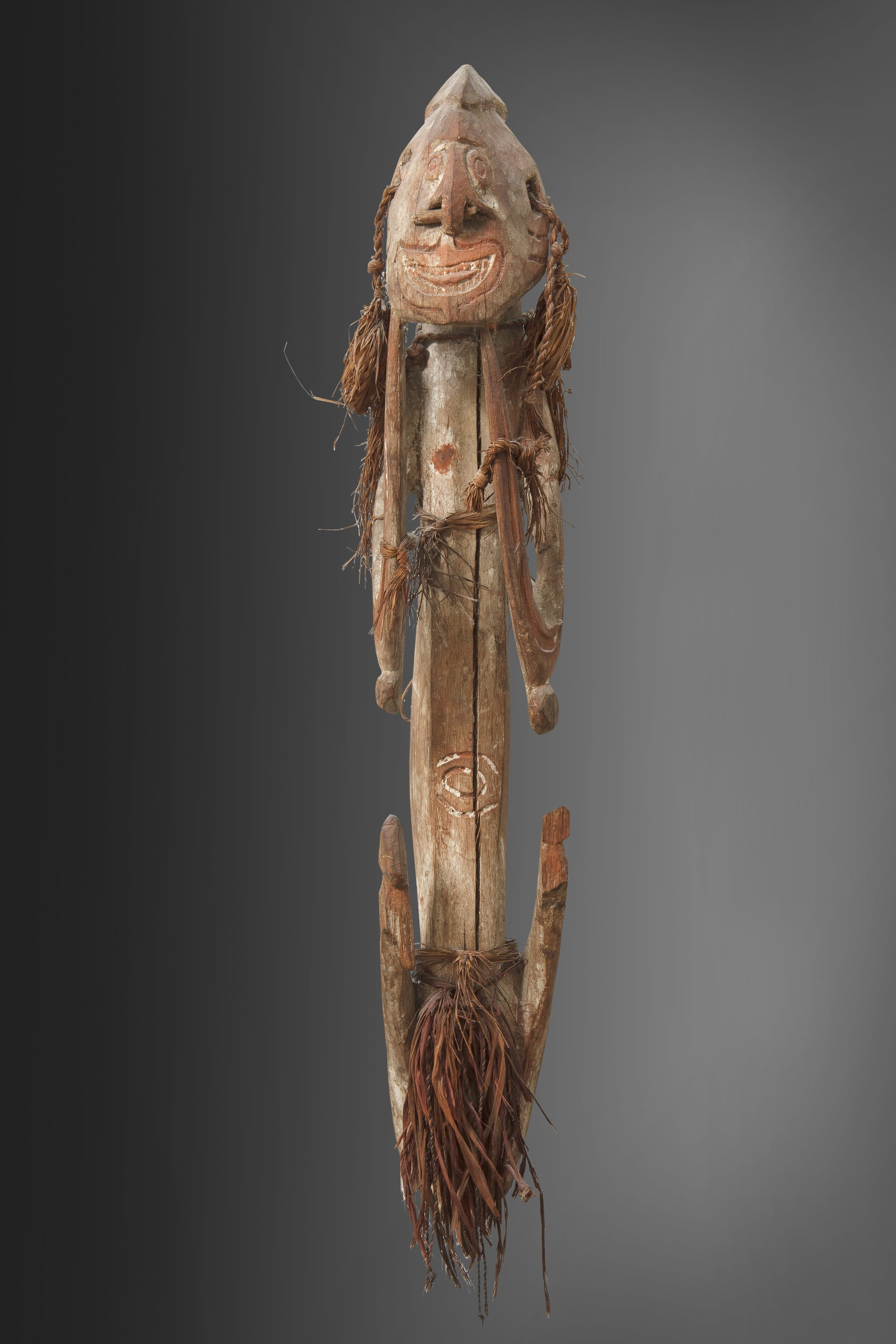 """Ancestor figure B, accompanied by a document typed by the collector indicating: """"Female Figure. Wide open mouth with tongue. Hands and legs bent. Missing legs below the knee. Hands touching the lower jaw. H. 70 cm. Hardwood and heavy, slightly colored. Originally entirely covered with white chalk. Incised lines painted red. Purchased at the MSC missionary house in 1950. Collected by Father Viegen ... Noordwest River. See P. Viegen in the  Annals,  1912–1913."""" Private collection. Photo: Jan van Esch."""
