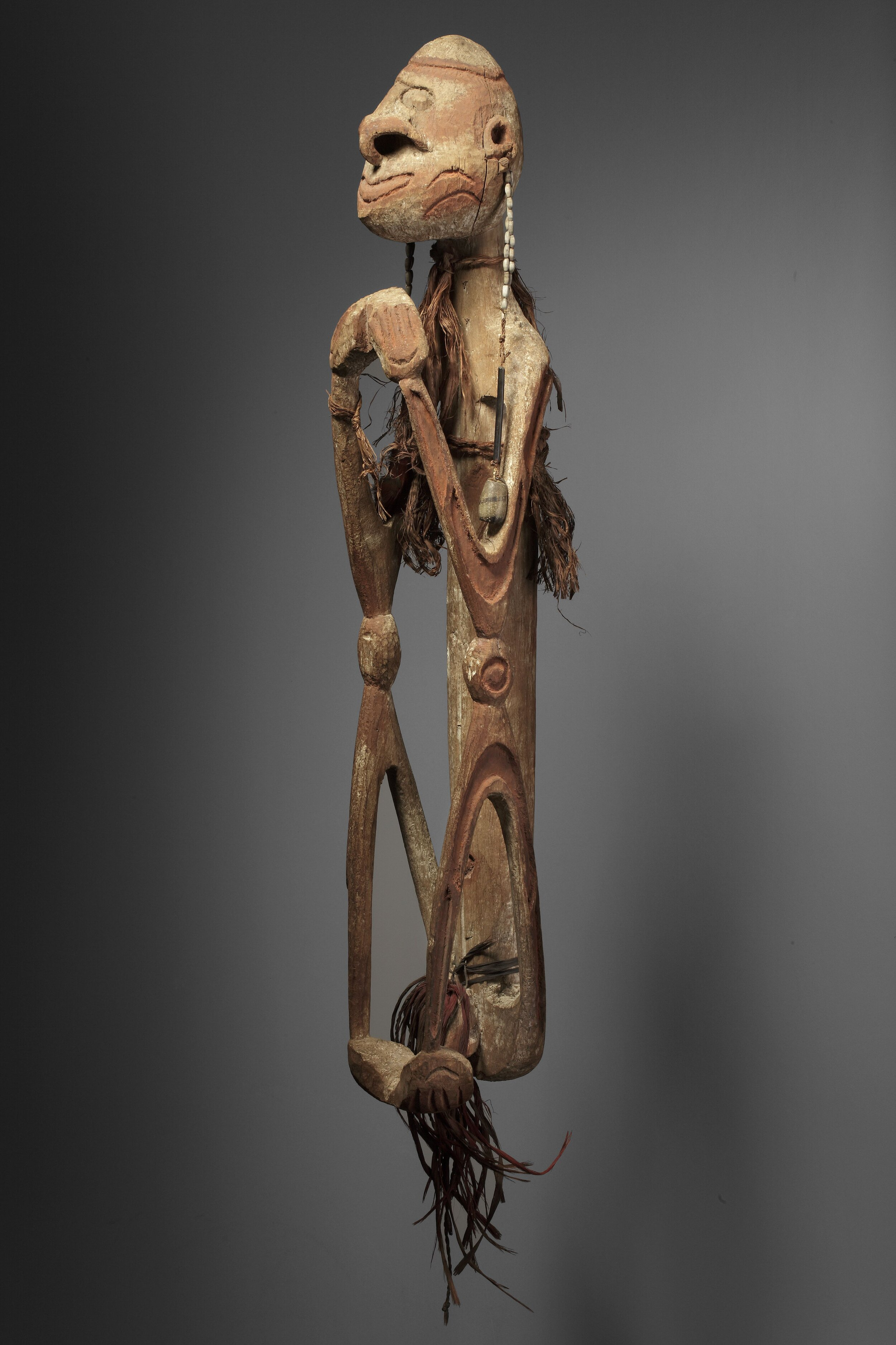 """Ancestor figure D, accompanied by a document typed by the collector indicating: """"Male figure. Hands clasped tightly under the chin, also with both feet. Arms and legs bent. H: 77 cm. Soft wood and light, originally fully painted with lime. Red incised lines. Purchased at the MSC missionary house in 1950. Collected by Father Viegen ... Noordwest River. See P. Viegen in the  Annals  1912–1913."""" Private collection. Photo: Jan van Esch"""
