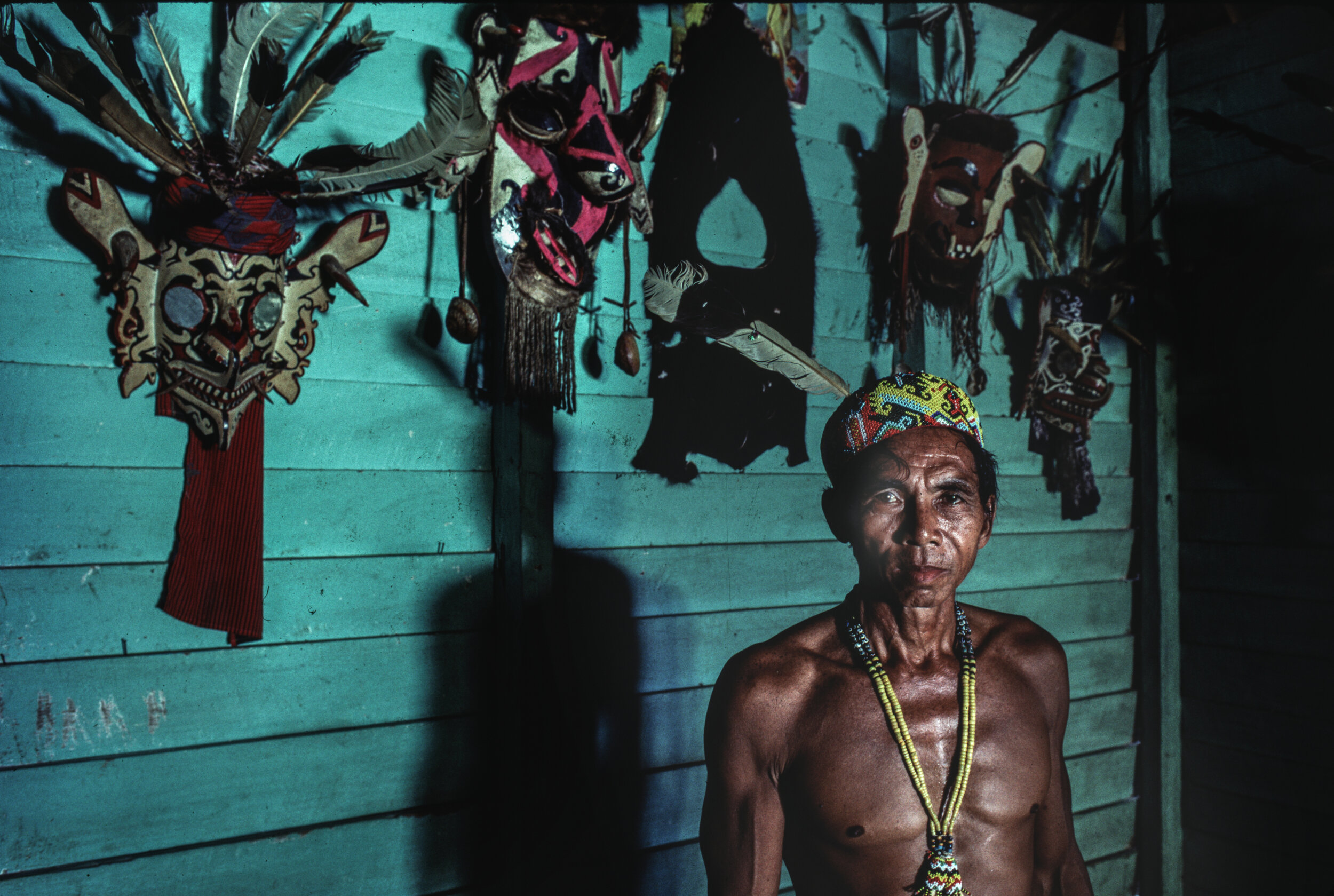 Pak Jehnau Ding, guardian of the sacred Hudoq masks associated with fertility and the earth, in the Bahau Dayak village of Long Hubung on the mid-section of the Mahakam river. 1990. © Rio Helmi