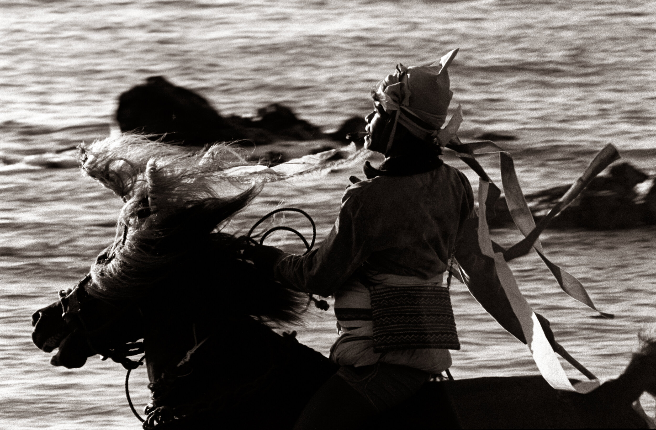 The rider designated to open the Pasola ritual battle on horseback in Wanokaka, West Sumba, rides across the beach, before the whole battle gets moved inland. © Rio Helmi