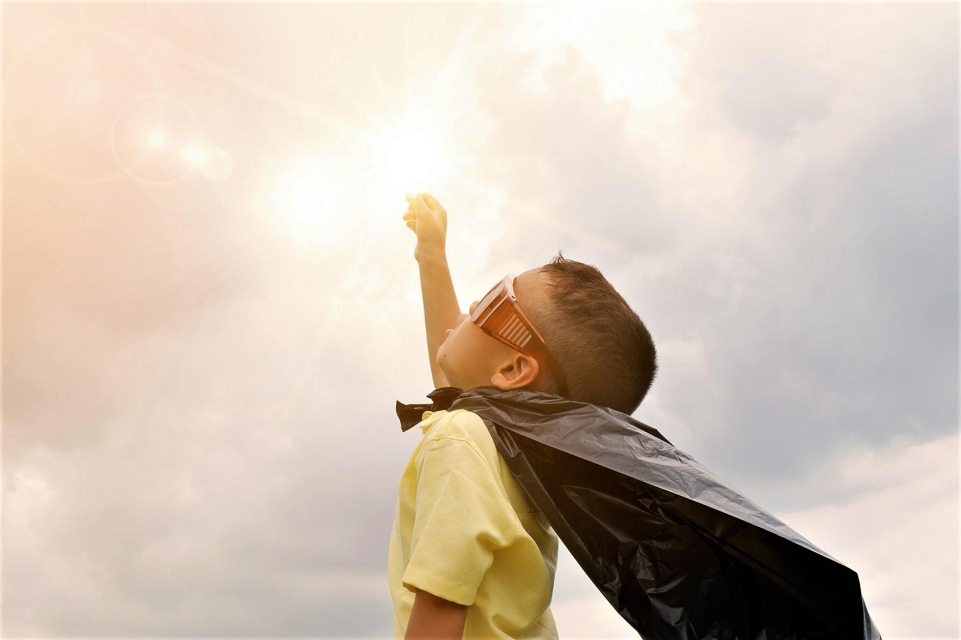 Boy with Superhero cape Pexels.jpeg