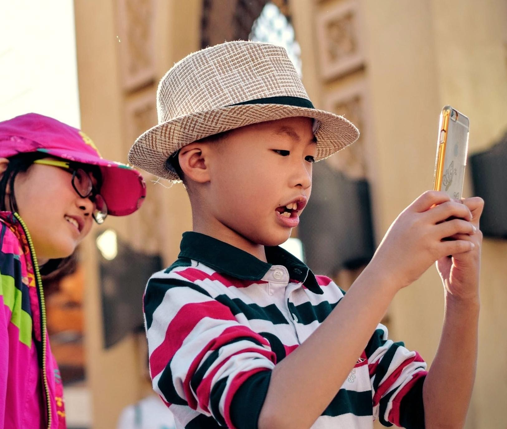 Asian boy with phone Pexels.jpg