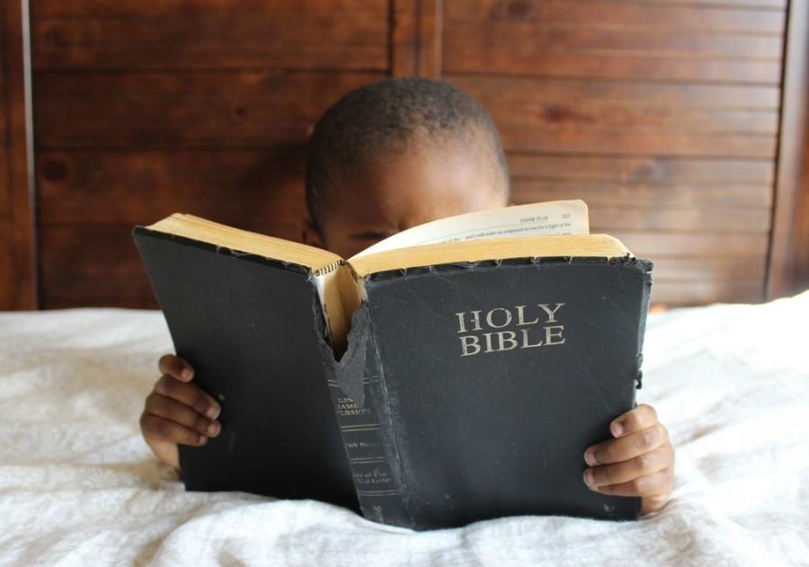 Bible boy on bed.jpeg