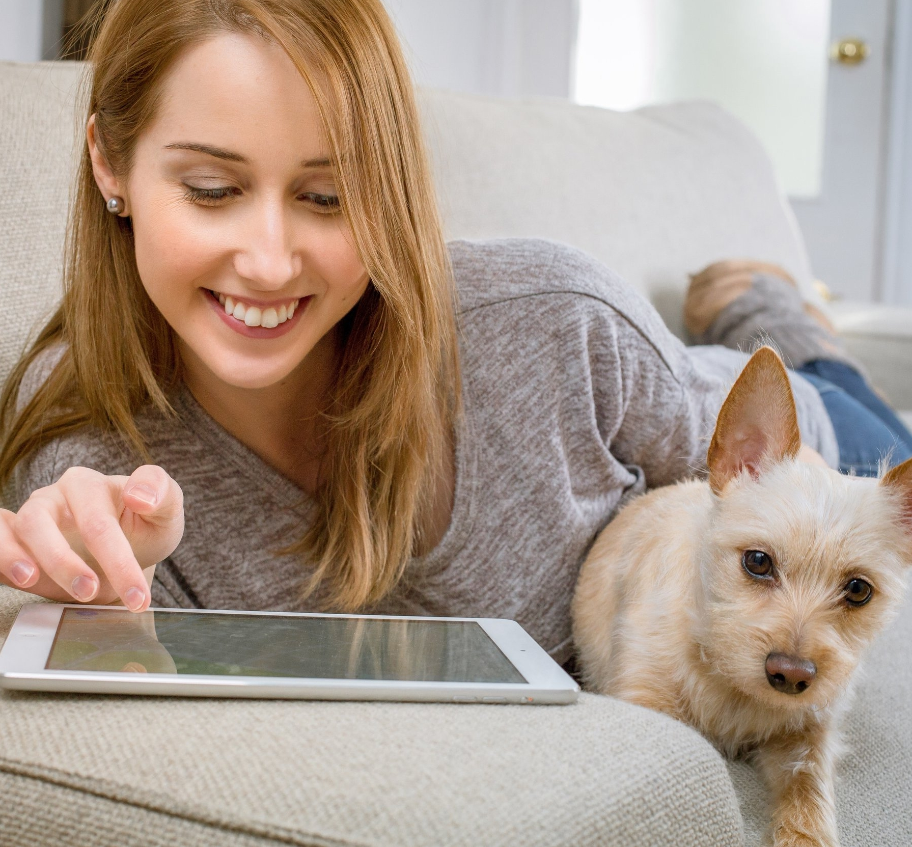 Girl with ipad and dog.jpg
