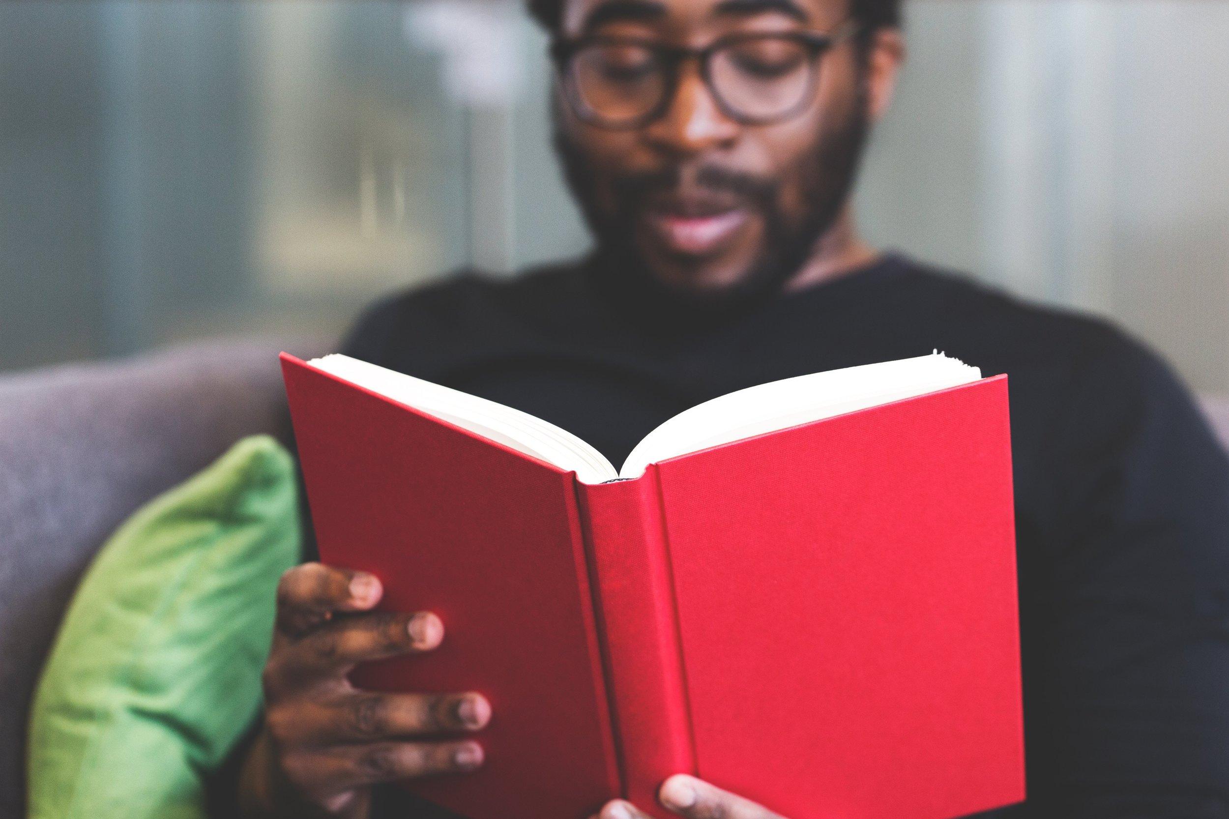 Black guy reading book Pexels.jpg