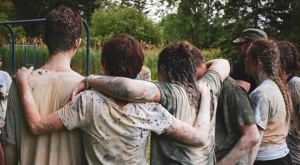 muddy+teens+arm+in+arm.jpg
