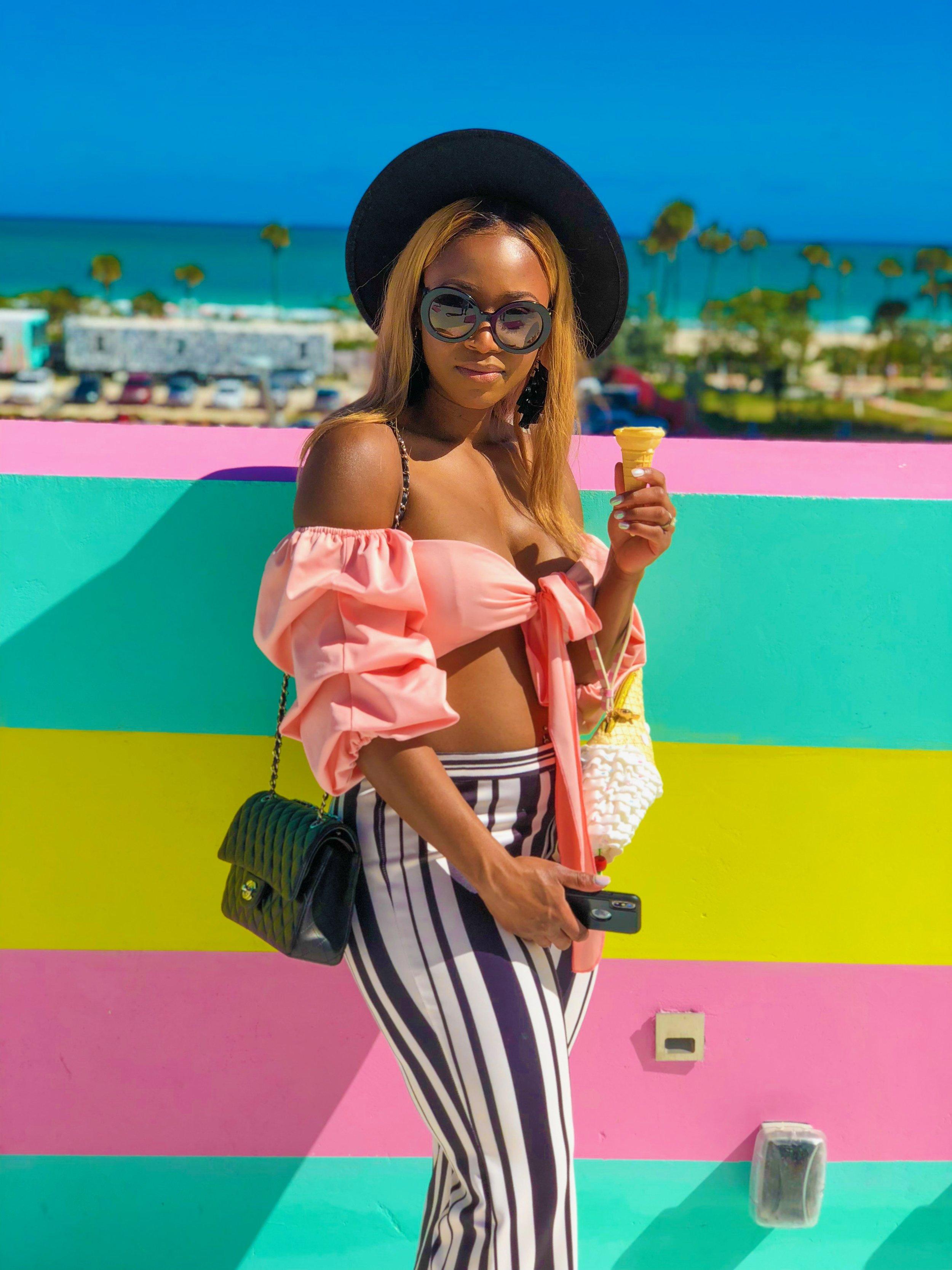 Location: The Museum of Ice Cream Miami  Top: Agaci  Pants: Top Shop  Hat: Boohoo  Sunglasses: Prada  Ice cream purse: Betsey Johnson  Handbag: Chanel