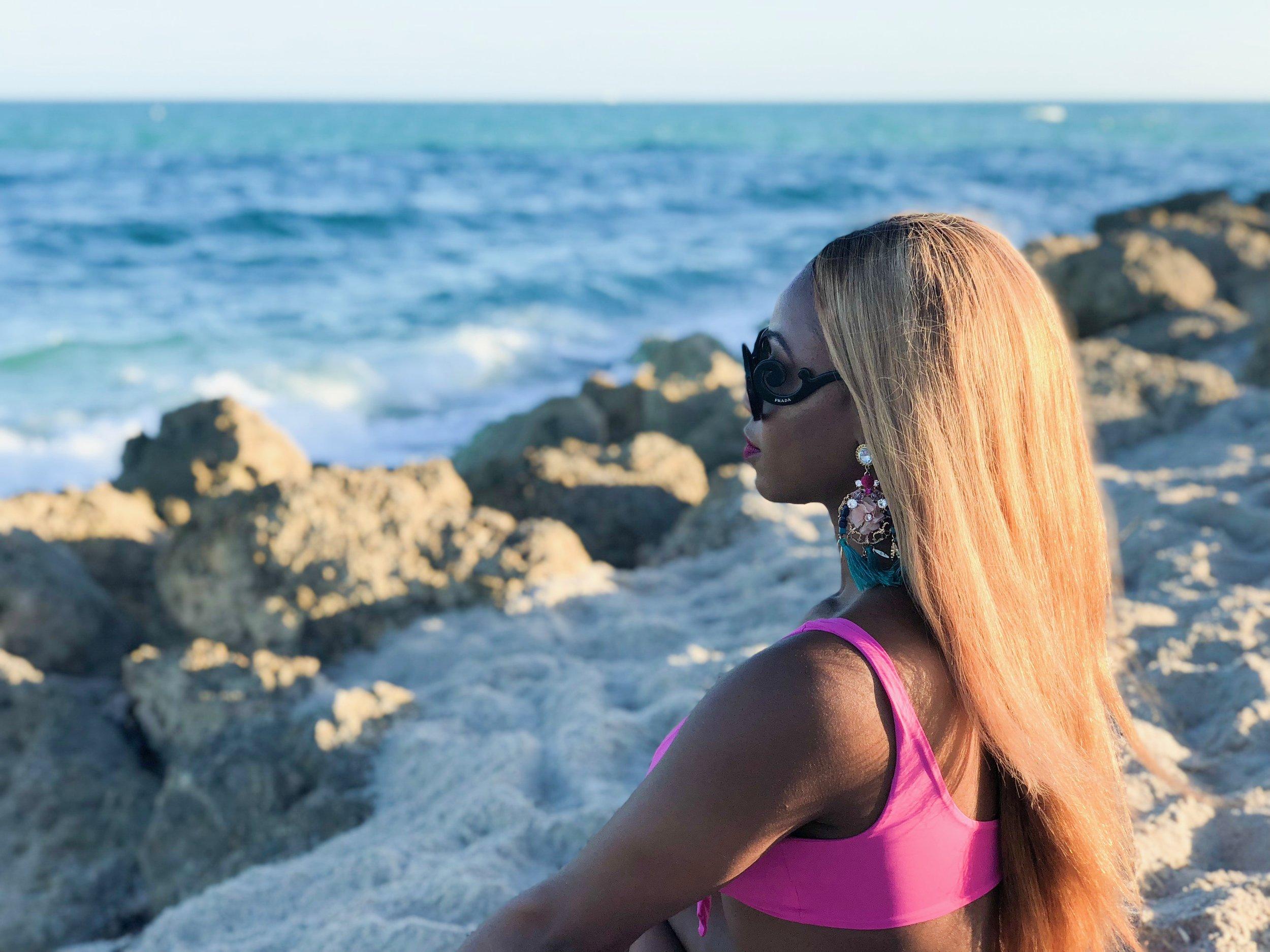 Location: Faena (beach)  Swimsuit: Amazon  Sunglasses: Prada  Earrings: Aldo accessories
