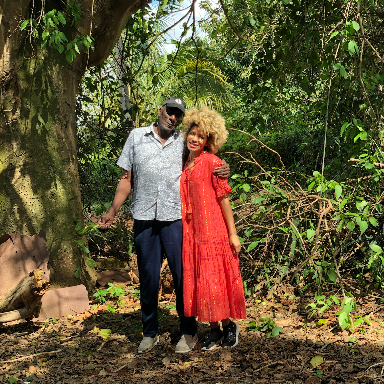 Leysa with her father in Cuba, next to a tree that was planted in the 1890's